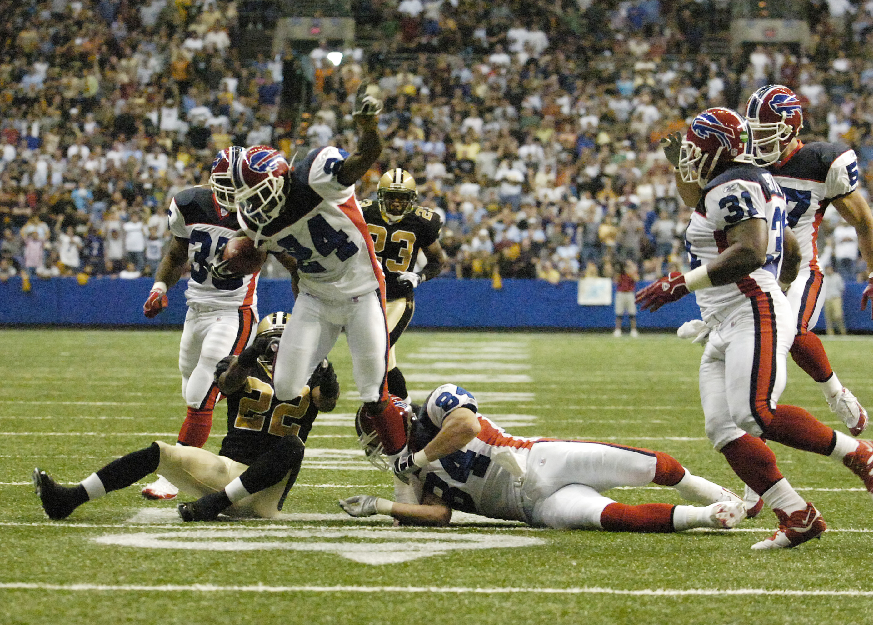 FOR SPORTS , Action of Buffalo Bills vs New Orleans Saints in the Alamodome in San Antonio, Texas on October 2,2005 Photo by James P. McCoy Buffalo News staff photographer Terrence Mcgee gets tripped up on the 15 yard line almost making a td on the kick off