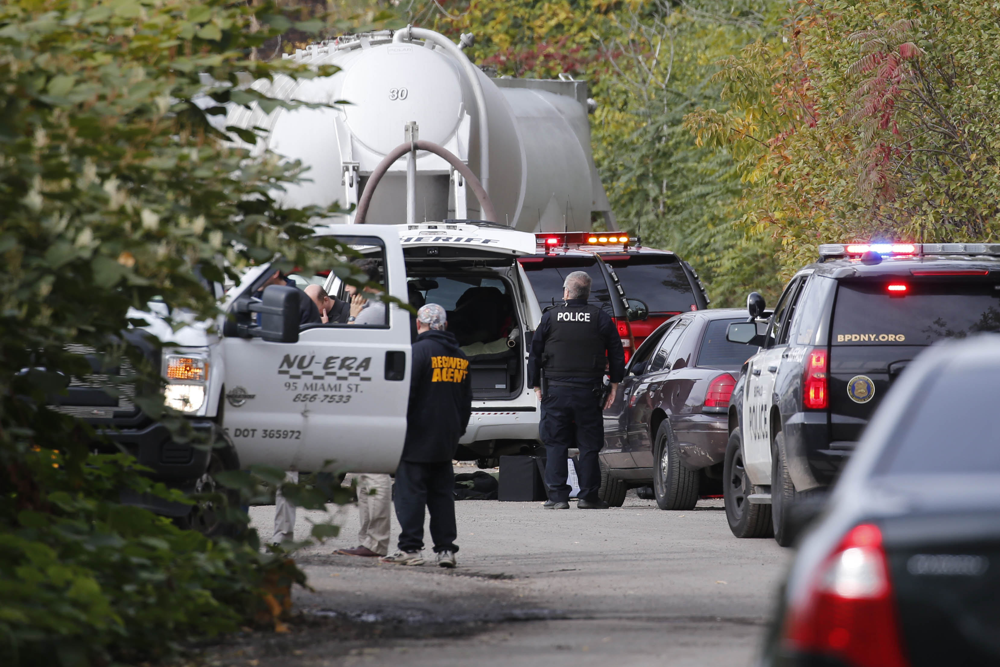 Law enforcement officials, including the Erie County Sheriff bomb squad, are investigating on scene at Nu Era on Miami Street, Wednesday, Oct. 26, 2016.  (Derek Gee/Buffalo News)
