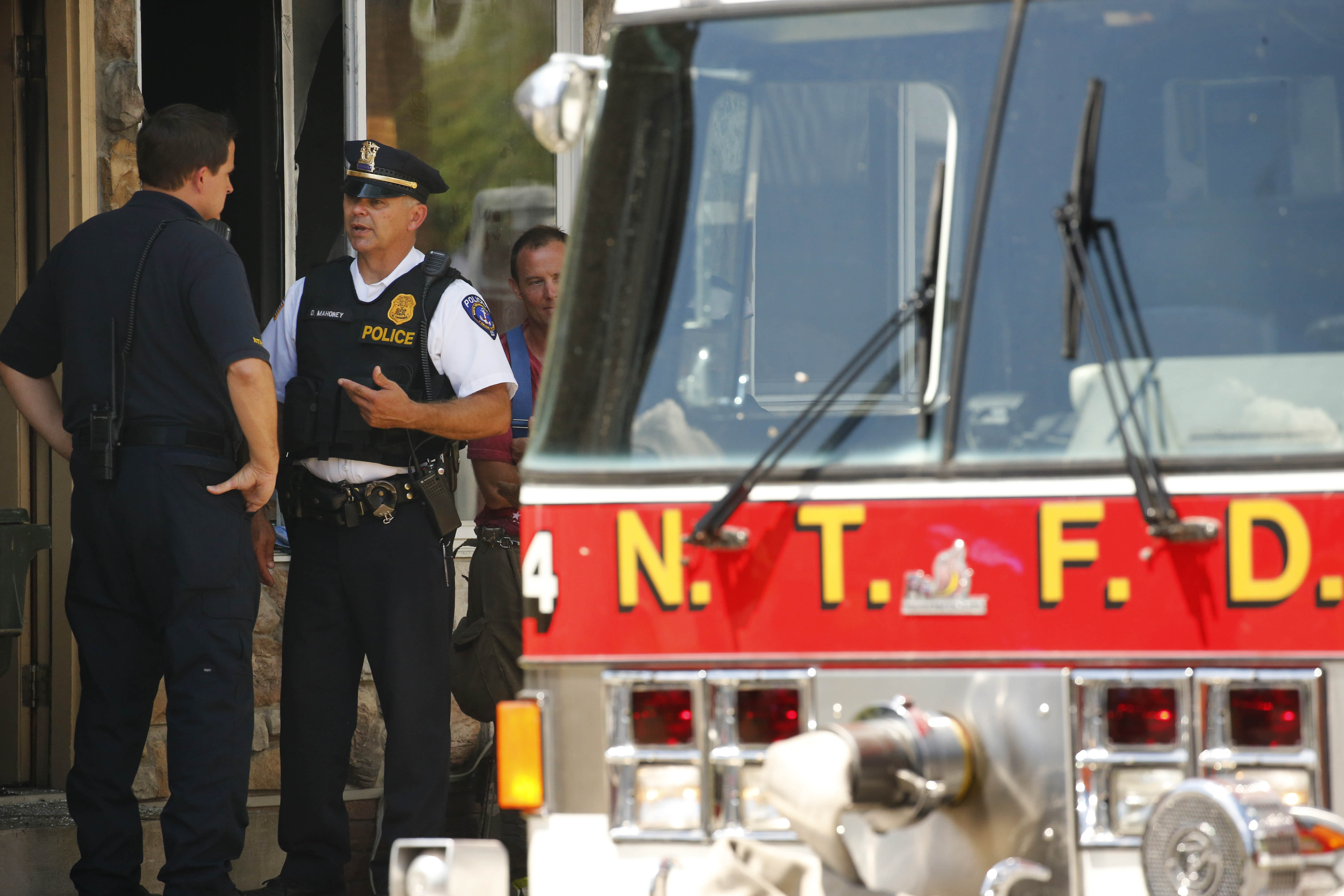 North Tonawanda fire and police officials investigate at the scene of a fire on Wednesday, Aug. 3, 2016.  (Photo by Derek Gee)