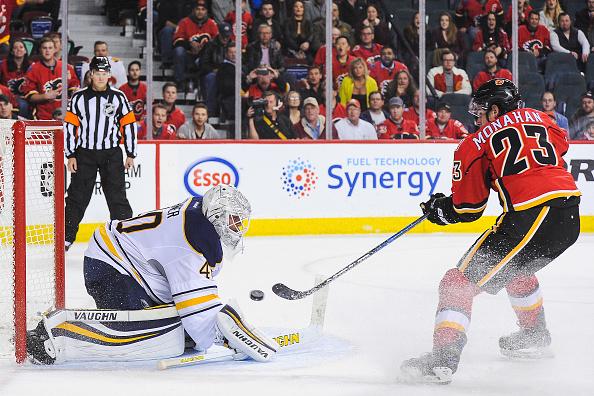 Calgary's Sean Monahan beats Sabres goalie Robin Lehner for the game-winning goal in overtime (Getty Images).