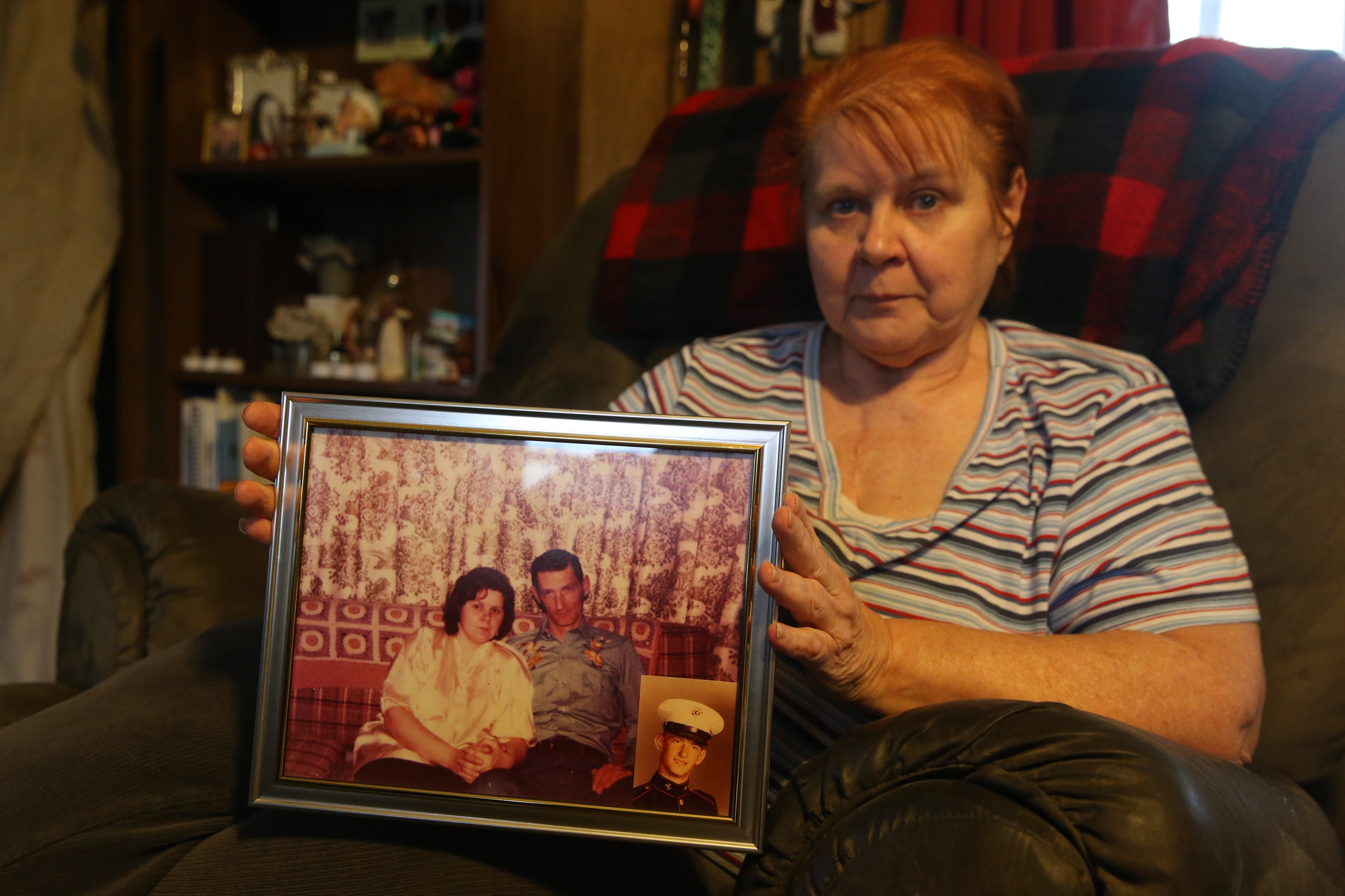 Patricia Lord contracted Legionnaires' disease in September 2016, but survived. She's seen here at her home in Middleport, N.Y. on Thursday Oct. 27, 2016, with of photo of her and her ex-husband, Richard A. Jepson of Lockport, who died from  Legionnaires' disease July 22.  (John Hickey/Buffalo News)