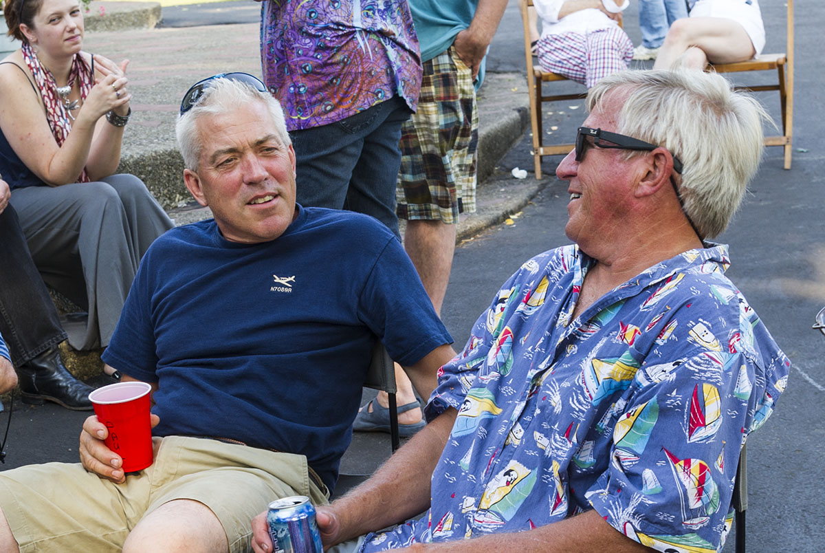 Pilots Paul Rosiek, left, and Richard Walker chat in an undated photo. Rosiek, of Hamburg, and Walker, of Eden, along with Walker's wife, Kathleen, died when their planes collided mid-air above North Collins on Sept. 25, 2016. (Courtesy of James Cavanaugh)