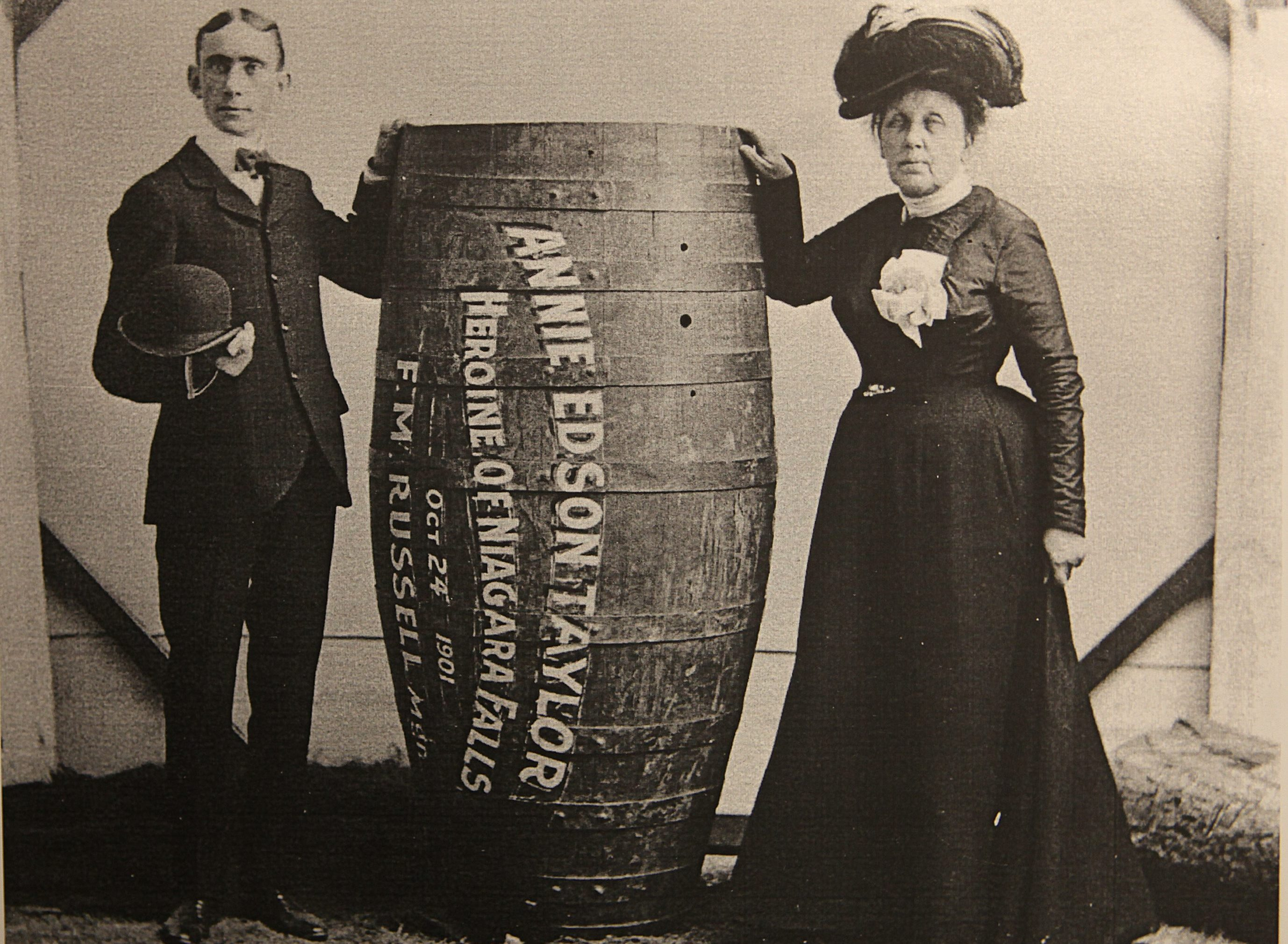 Annie Edson Taylor, the first person to successfully go over Niagara Falls in a barrel, with her manager.  (Buffalo News file photo)
