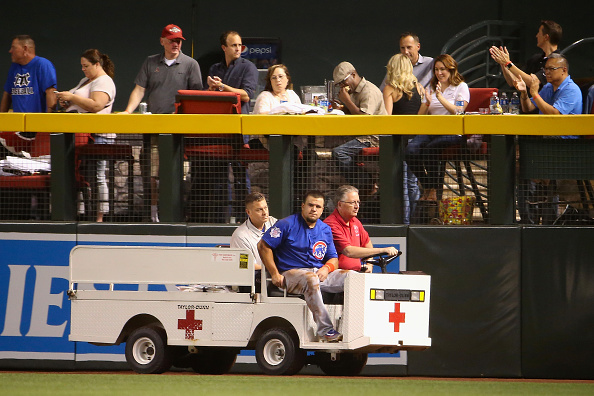 Kyle Schwarber was carted off the field with a serious knee injury April 7 in Arizona and returned Tuesday for Game One of the World Series (Getty Images).