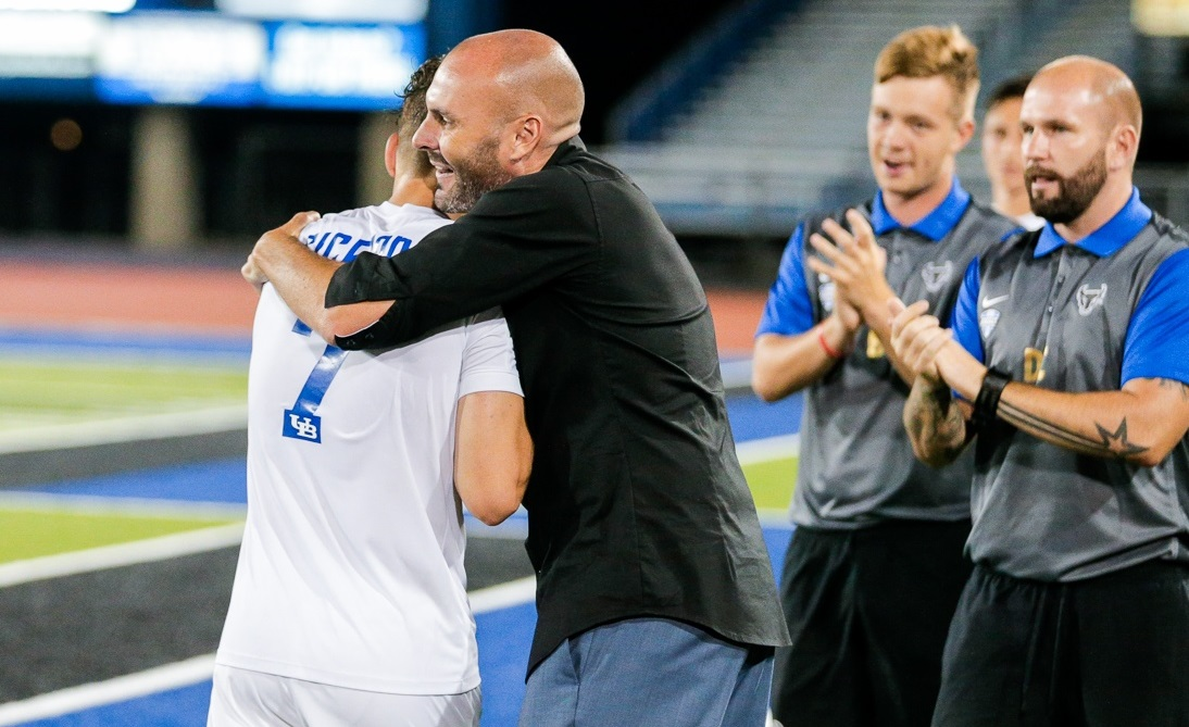 UB head coach Stu Riddle embraces Cicerone after setting the program's single-game record for goals, potting five against Daemen. (UB Athletics)