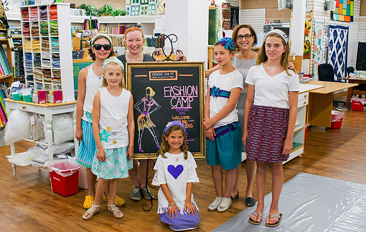 Fashion Lab campers from the Aurora Sewing Center show off some of their creations.