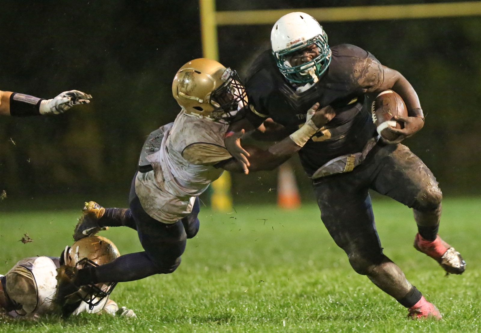 Joe Harrison (right) and his Bishop Timon-St. Jude Tigers  scored the lone touchdown in a regular-season triumph over Canisius. (Dave DeLuca/Special to The News)
