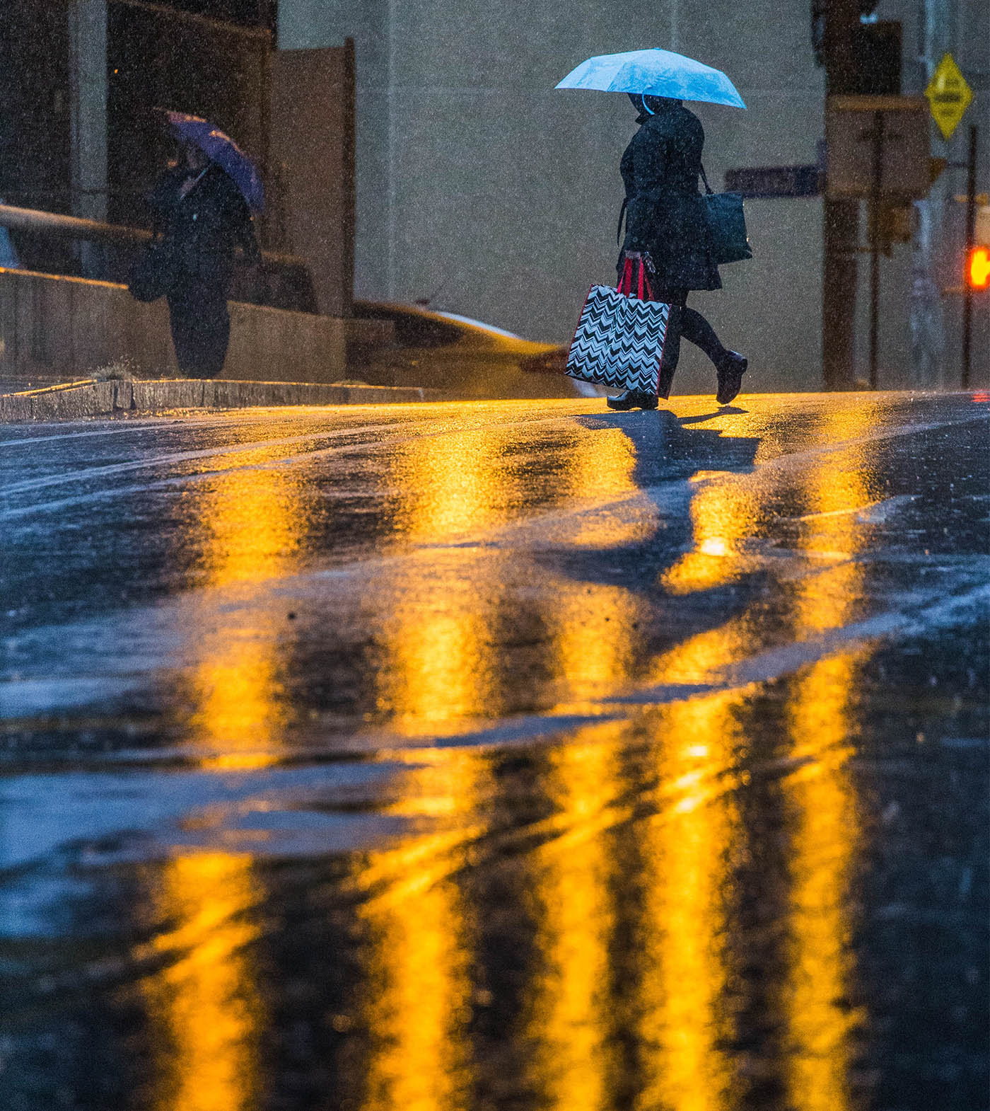 A pedestrian crosses Washington Street as heavy rain falls during the morning commute, Thursday, Oct. 20, 2016. (Derek Gee/Buffalo News)