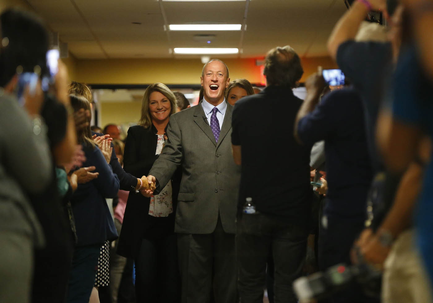 "Jim Kelly is greeted by ECMC administrators and staff before his ""Kelly Tough"" room dedication on the 10th floor of the hospital Tuesday, Oct. 18, 2016. It is the same room where he stayed when he received his treatment in 2013-14. (Mark Mulville/The Buffalo News)"