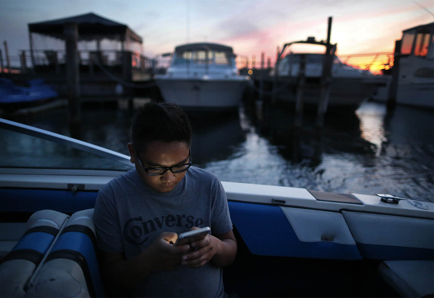Aung Kaung Myat relaxes on his boat in the Niagara River, Friday, Sept. 25, 2015. Myat came to Buffalo as a refugee from Myanmar and now runs a thriving business. (Photo by Derek Gee / Buffalo News)