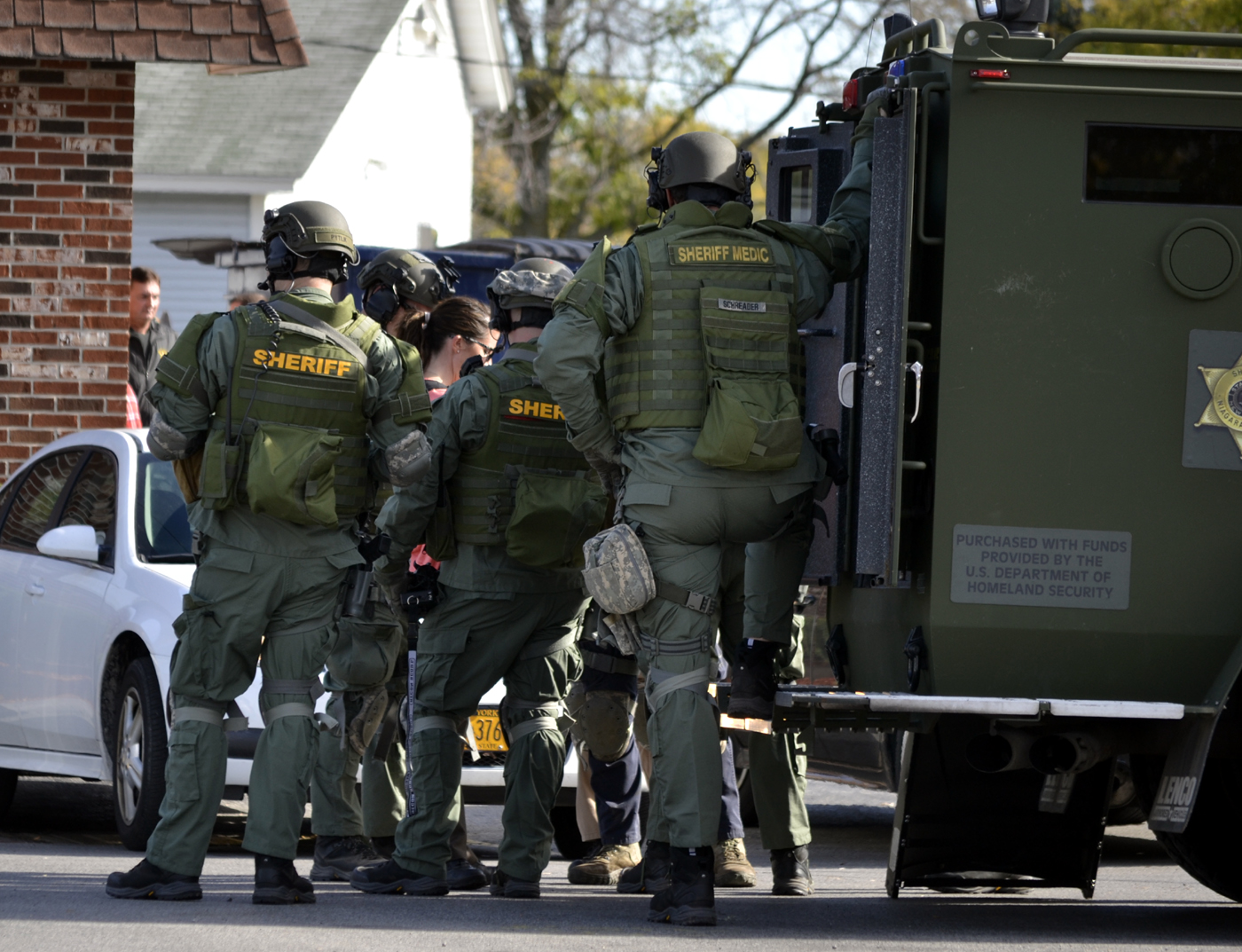Niagara County sheriff's deputies surrounded a house in the 2900 block of Niagara Falls Boulevard  on Monday, Oct. 31, 2016 after receiving a complaint about a domestic violence incident involving a man with a gun. The situation ended when a male suspect exited the home unarmed and was arrested. (Photo by Larry Kensinger)