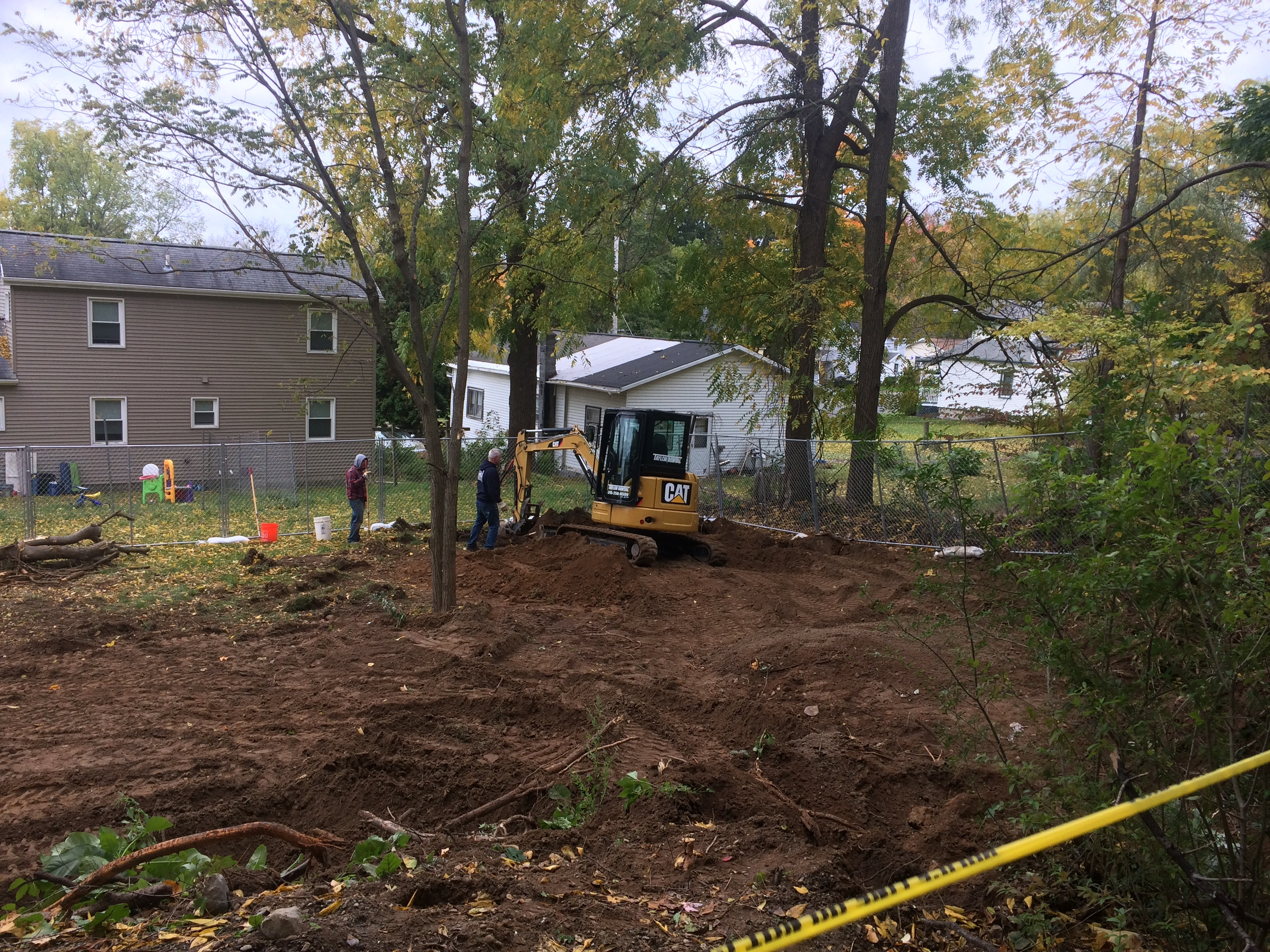 A view from Fort Hill Cemetery in Auburn as workers excavate for the remains of prisoners in the yard of Eric and Alicia Johnson. (Sean Kirst/Provided image)