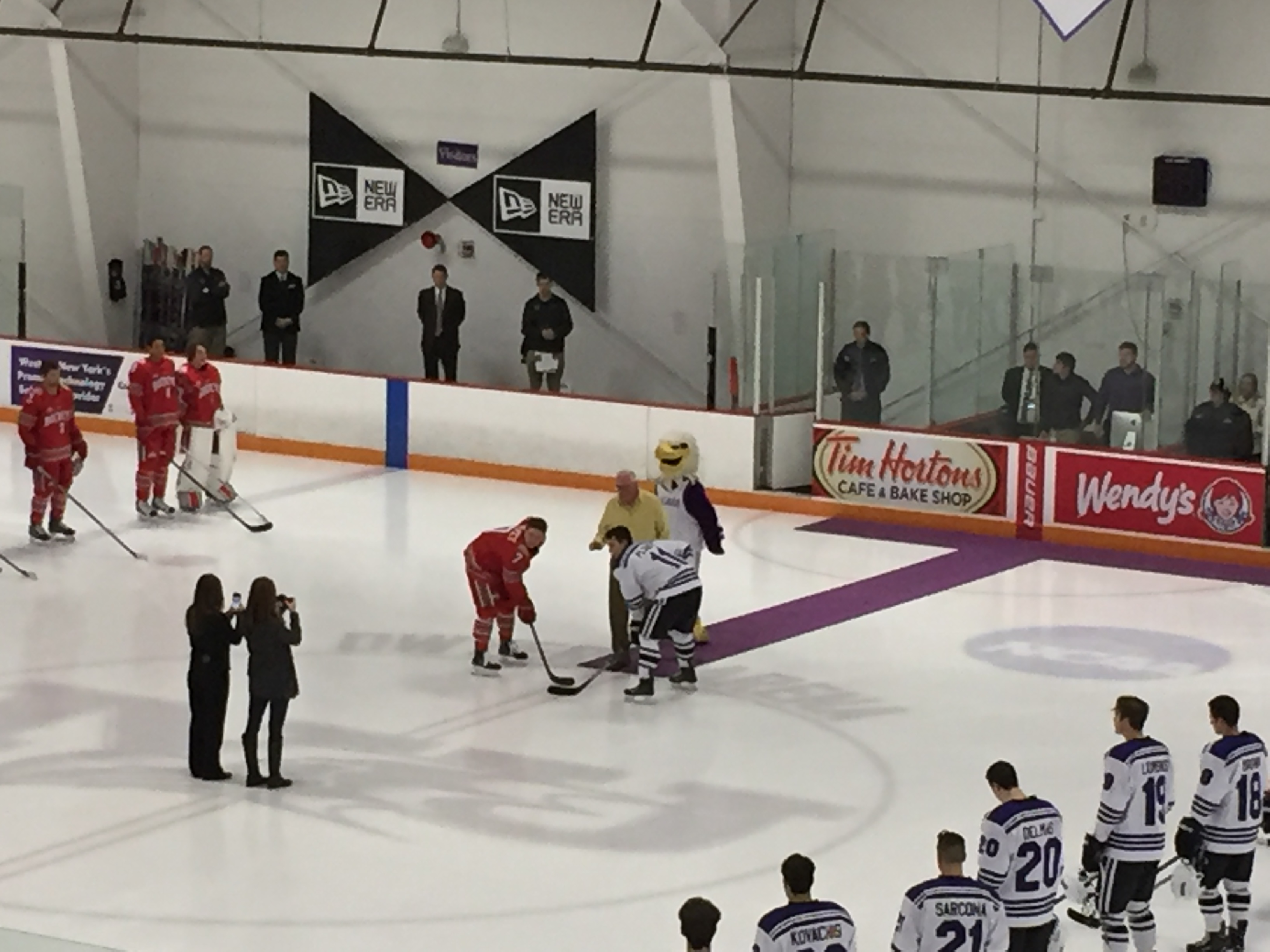 Bob Dwyer, the namesake of Dwyer Arena, dropped the ceremonial first puck Friday.