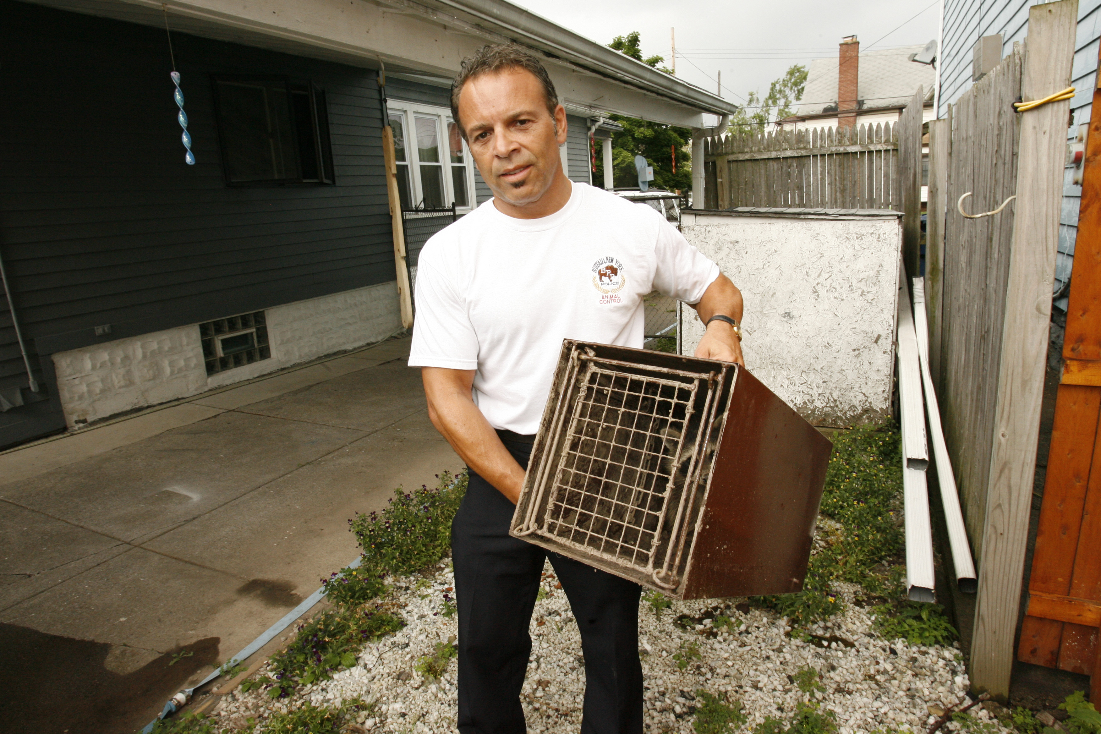 Robert Licata, in 2007, while working as city exterminator. (Buffalo News/ James McCoy )