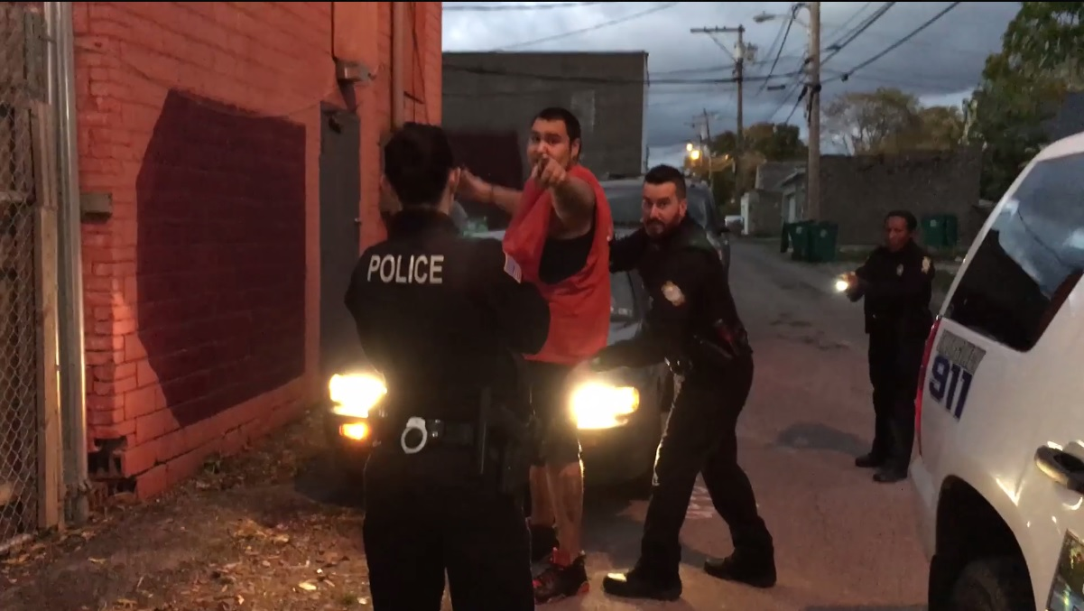 A screenshot of a video posted on Nick Quattrini's Facebook page shows Evan Stafford, 26, being arrested by police. He was charged with assault and attempted robbery.