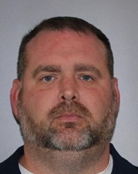 Christopher M. Claud, 42, of Lockport was charged with forcibly touching an inmate.(State Police)