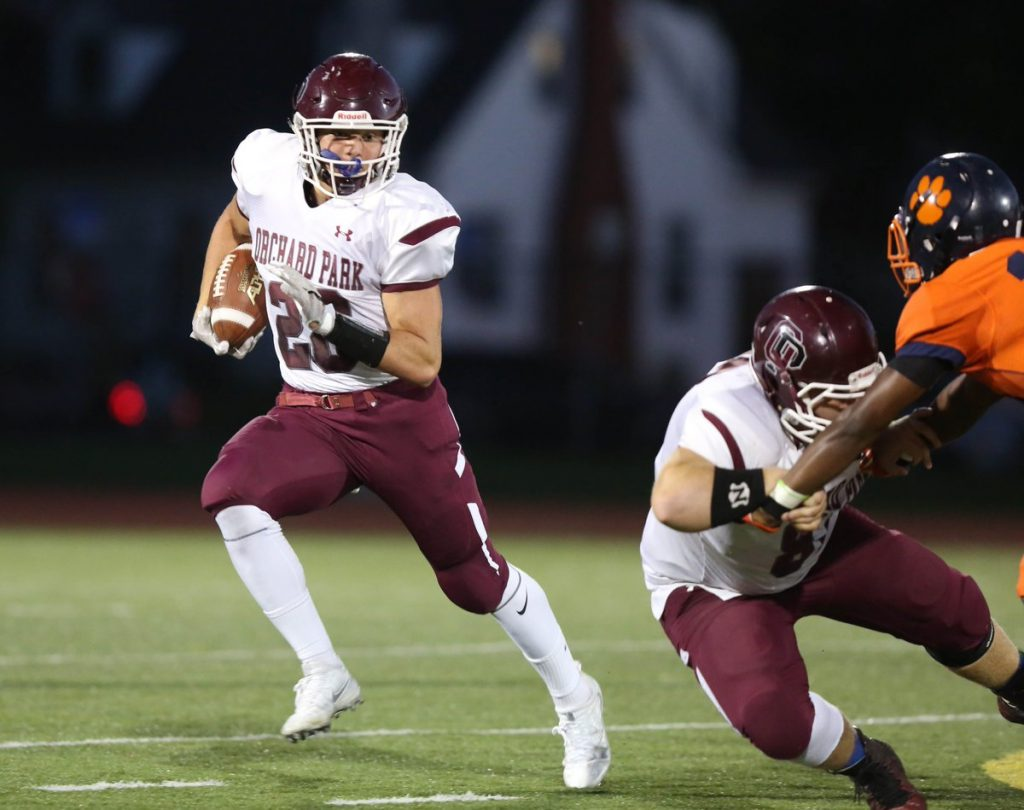 Josh Dahl rushed for 109 of his 170 yards during the second half as Orchard Park ground and pounded its way to a six-point win over Bennett on Friday night. (Dave DeLuca/Special to The News)