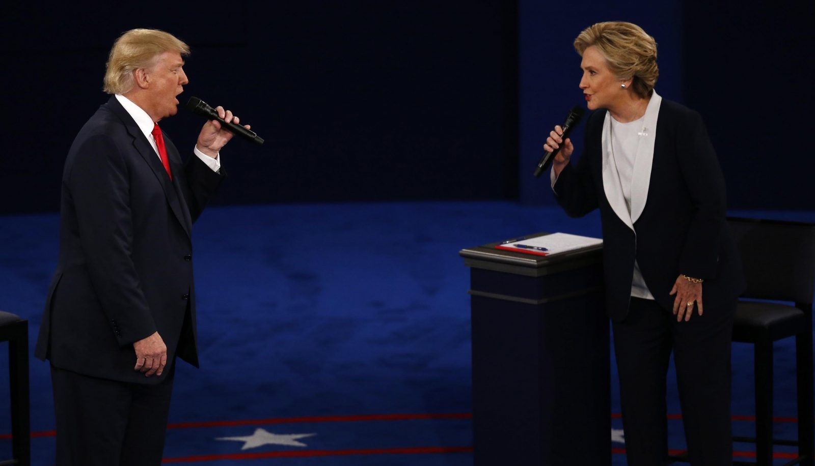 Donald Trump and Hillary Clinton spar at the presidential debate at Washington University. (Bloomberg photo by Andrew Harrer)