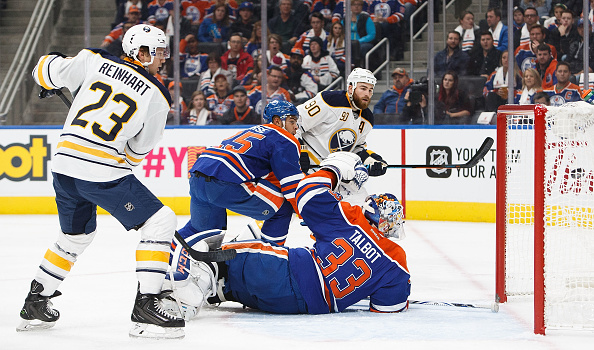 Ryan O'Reilly scores his power-play goal Sunday in Edmonton as Sam Reinhart looks on (Getty Images).