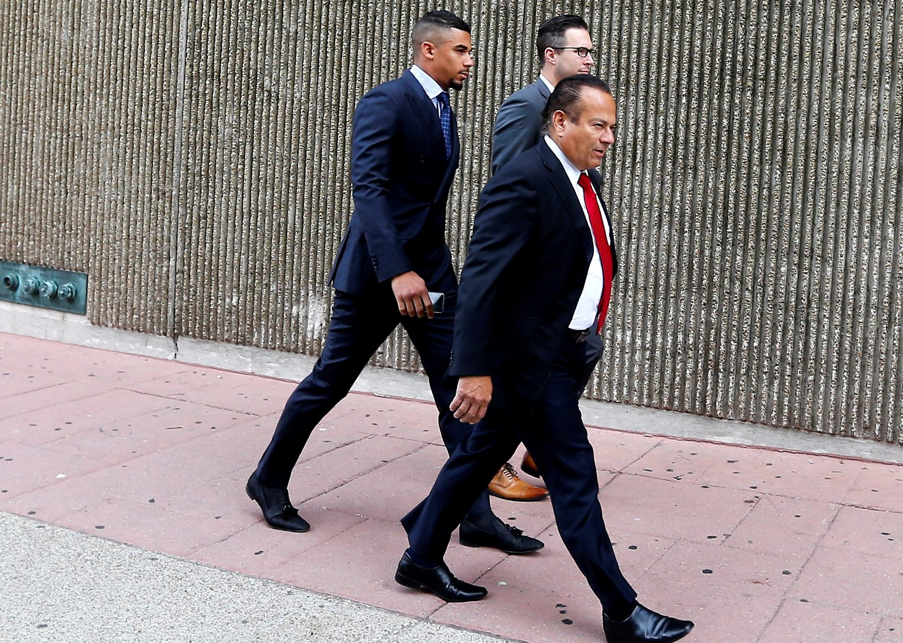 Buffalo Sabres forward Evander Kane enters city court with his attorneys on Aug. 1, 2016. (Mark Mulville/News file photo)