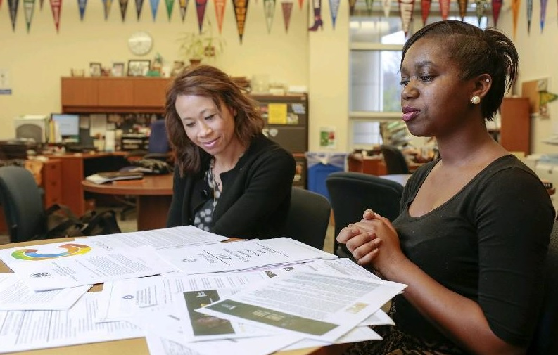 Vikaya Powell, 17, right, confers with Patricia Braun, College and Career Specialist. (photo for The Washington Post by Dayna Smith).