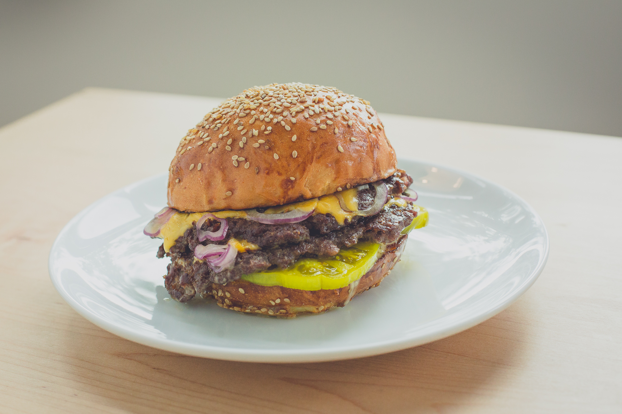 Pickled green tomatoes and free-range, grass-fed beef combine to make The Grange burger a local enterprise.