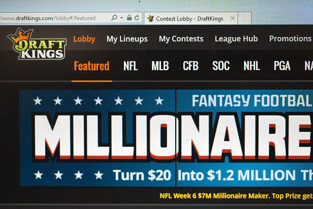 """On Tuesday, daily fantasy sports sites DraftKings and FanDuel signed off on a deal that will require them to, among other things, """"clearly and conspicuously"""" disclose information about conditions and terms of marketing promotions. (Getty Images)"""