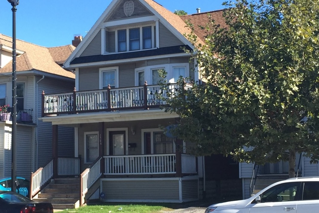 The home where a woman was found fatally beaten in the upstairs apartment. (Aaron Besecker/Buffalo News)