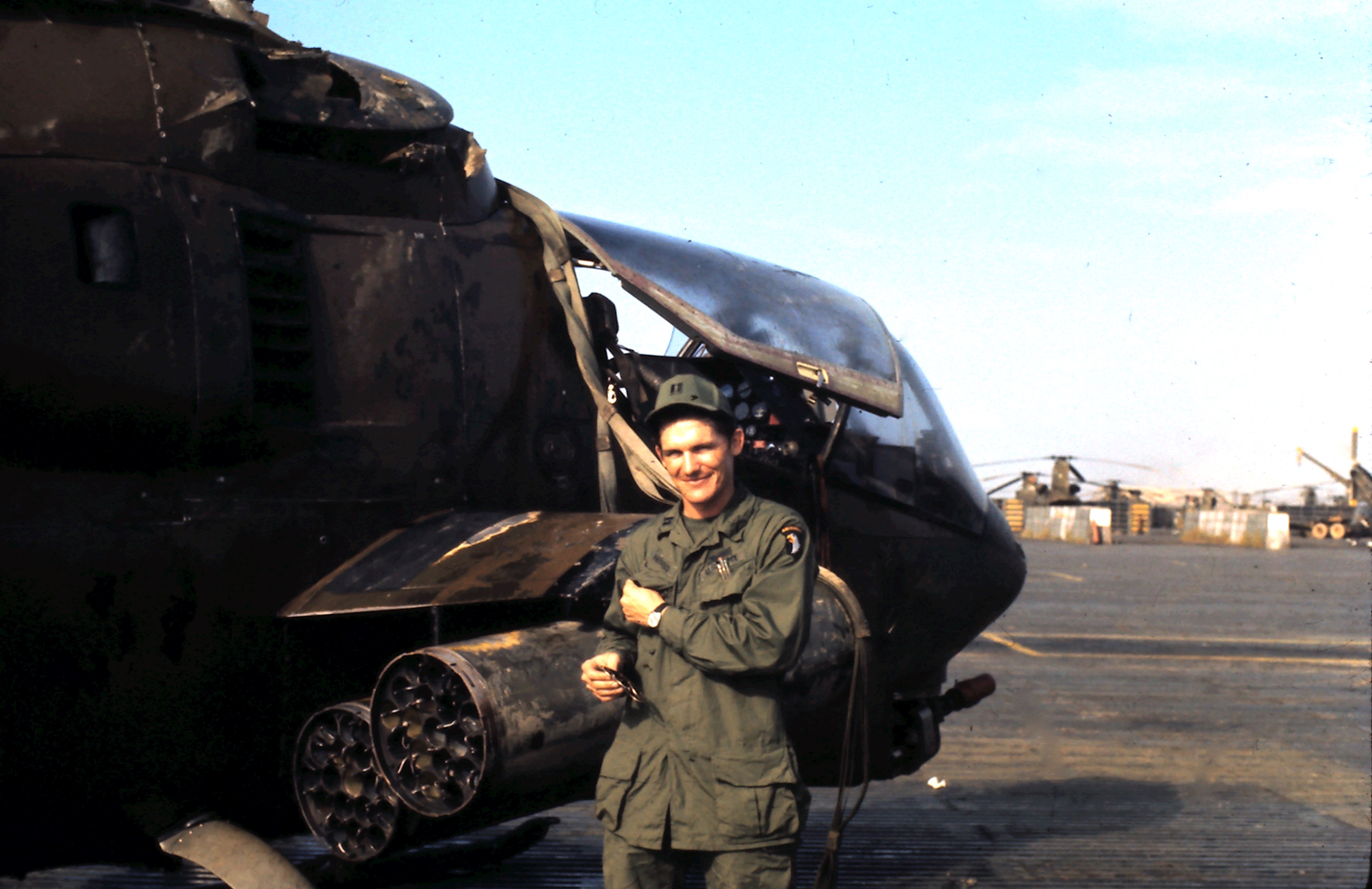 Capt. Michael E. Neufeld stands in front of a Cobra attack helicopter on Jan. 20, 1972 at an Army base in Phu Bai, Vietnam. A day earlier, Neufeld was shot down while flying the helicopter and survived. The helicopter is the centerpiece of a new Vietnam veterans memorial in Tonawanda. Photo courtesy of Jimmie D. Ferguson.