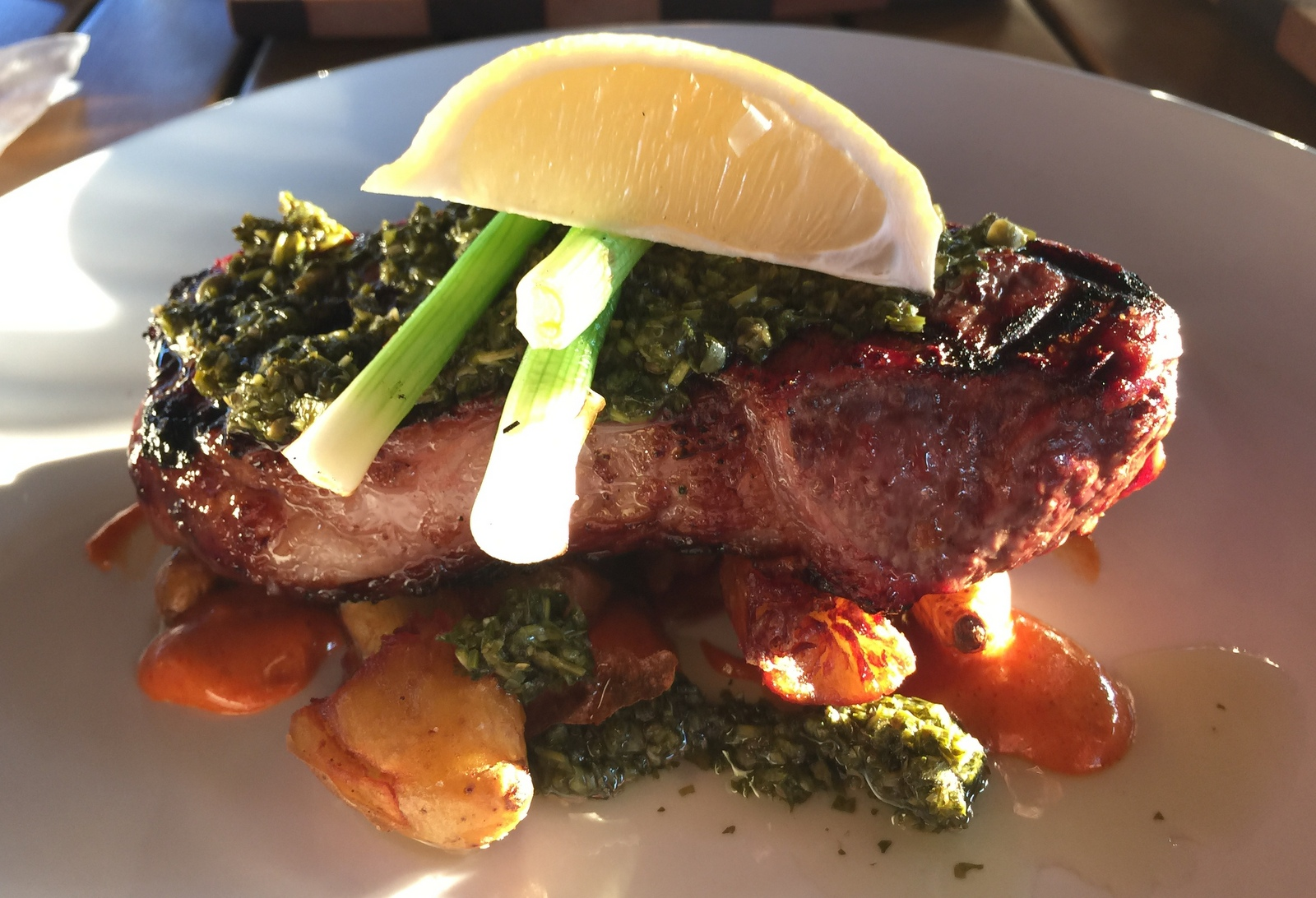 Steak with patatas bravas and chimichurri at The Oak Stave. (Andrew Galarneau/Buffalo News)