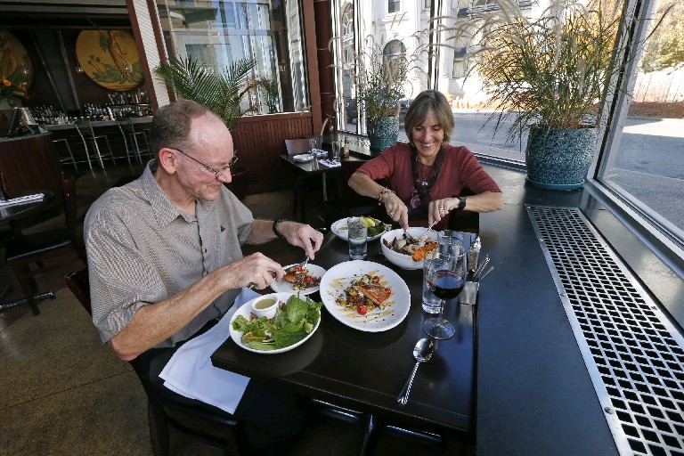 Martin and Carol DeNysschen skipped the bread and went right to Cioppino seafood stew and blackened salmon atop red quinoa and roasted regional farm vegetables during a recent visit to Oshun Oyster Bar in the Buffalo Theater District.