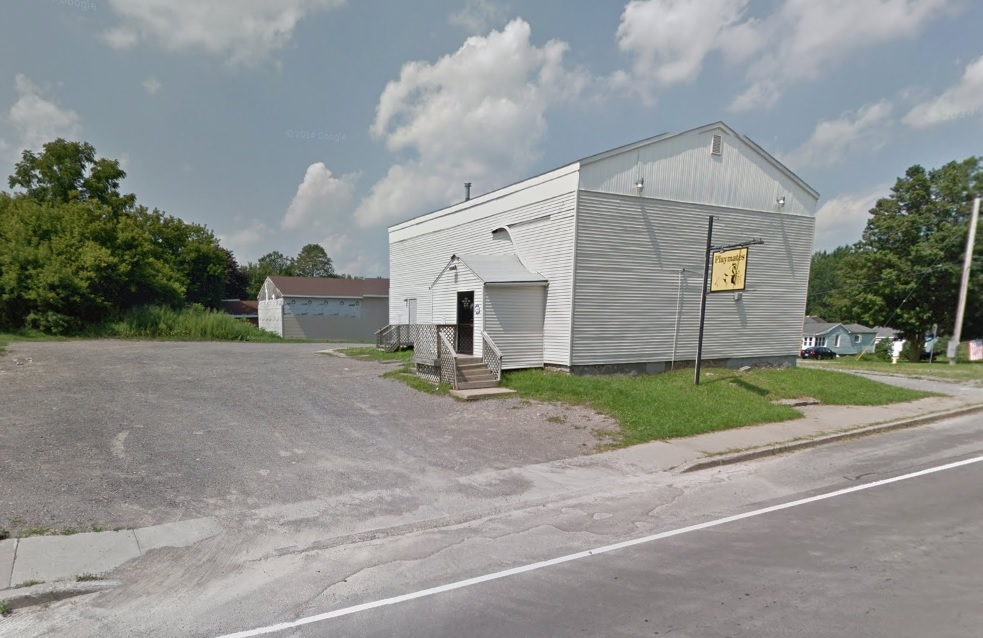 The parking lot outside a Genesee County strip club was the scene of a brutal assault, according to authorities. (Google Maps)