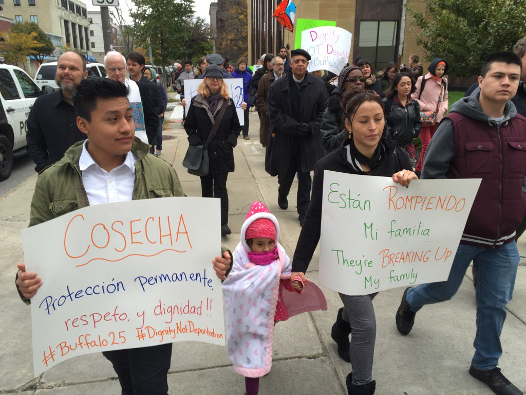 About 40 protesters are accompanying restaurant workers down Delaware en route to immigration hearings for workers arrested at four Mexican restaurants last week Buffalo. (Derek Gee/Buffalo News)
