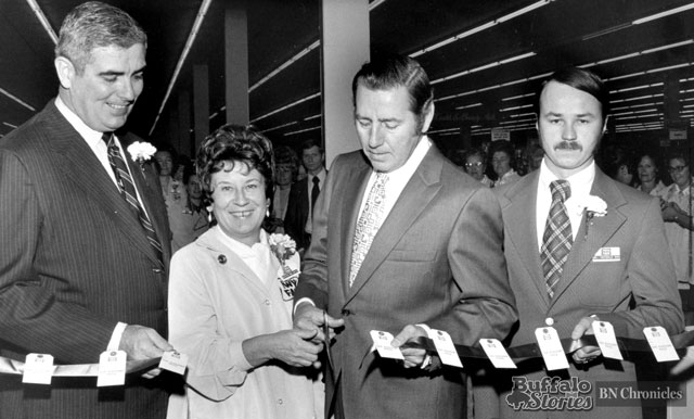 Cutting the ribbon on Twin Fair's tenth store, on Maple Road in Amherst. The site is now home to Tops. In the photo are Harold Egan, Twin Fair President; Edith McArdle, Twin Fair employee since 1958; Al Dekdebrun, Amherst Supervisor, sporting goods retailer, and 1946 Buffalo Bisons quarterback; and Andy Heferle, store manager.