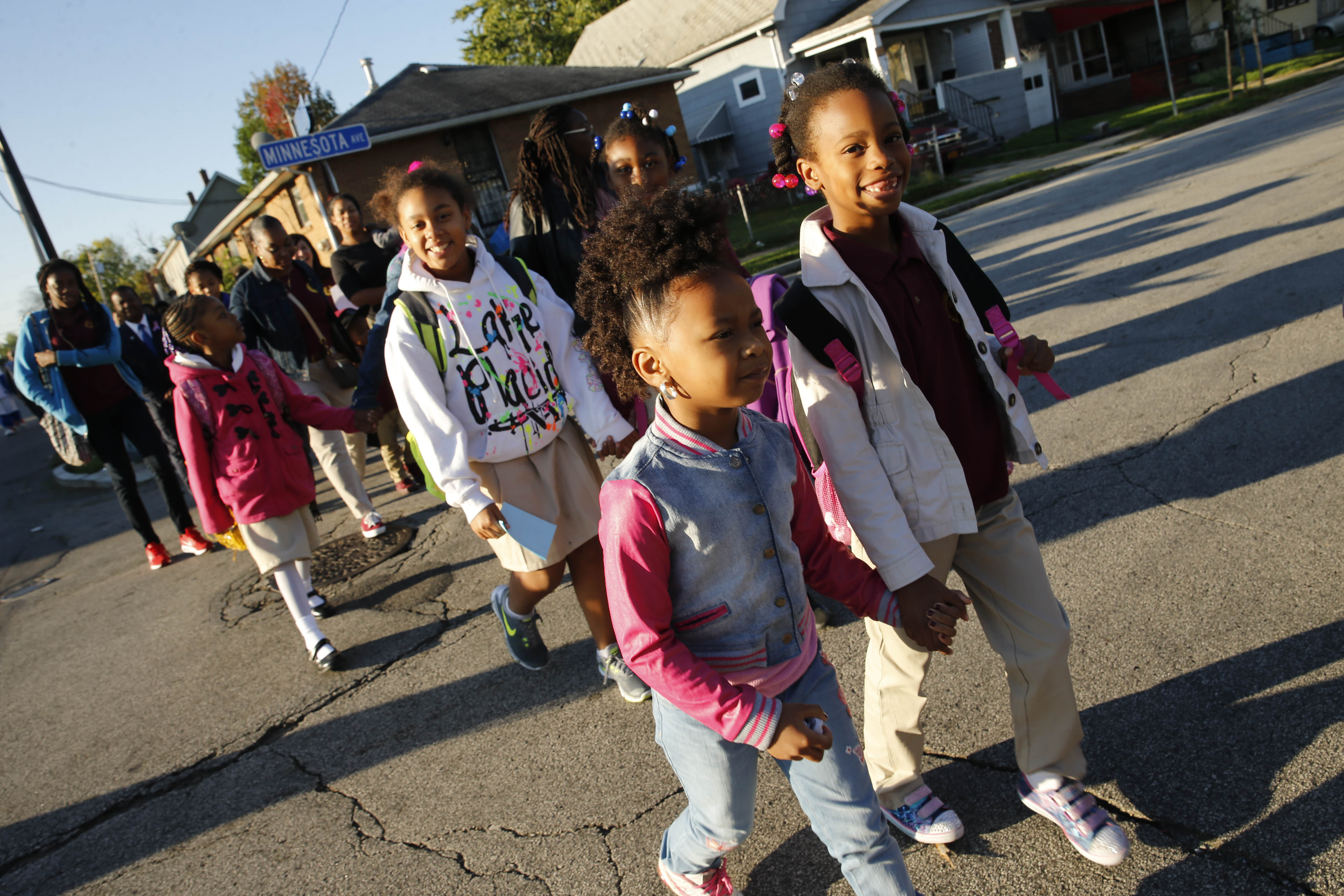 A group of students and faculty from Highgate Heights Elementary School walks down Orleans Street on their way to school as part of National Walk to School Day on Wednesday, Oct. 5, 2016.  (Derek Gee/Buffalo News)