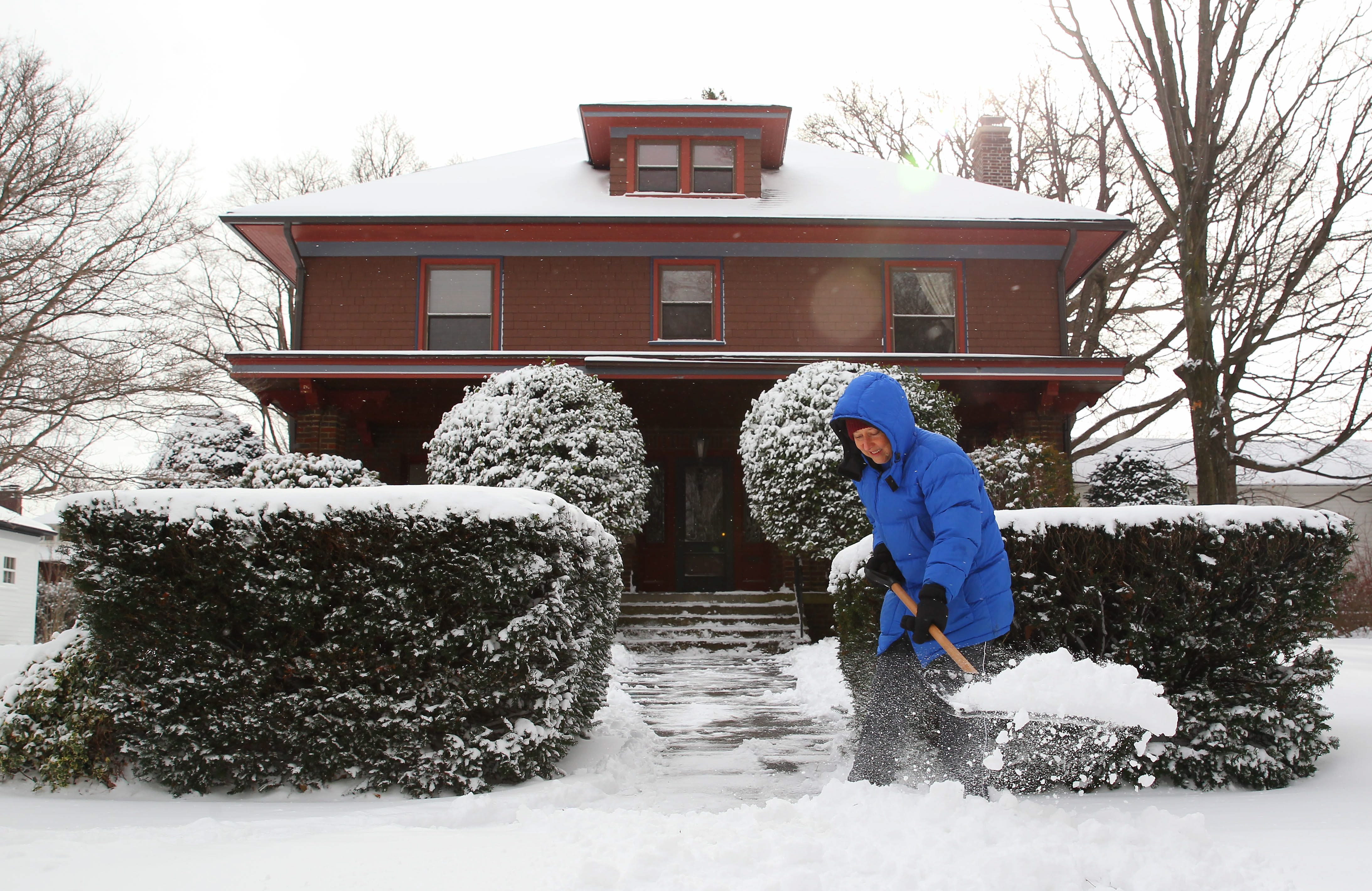 Terrie Miller clears the snow from in front of her home in Westfield Monday, Jan. 11, 2016.  (Mark Mulville/Buffalo News)