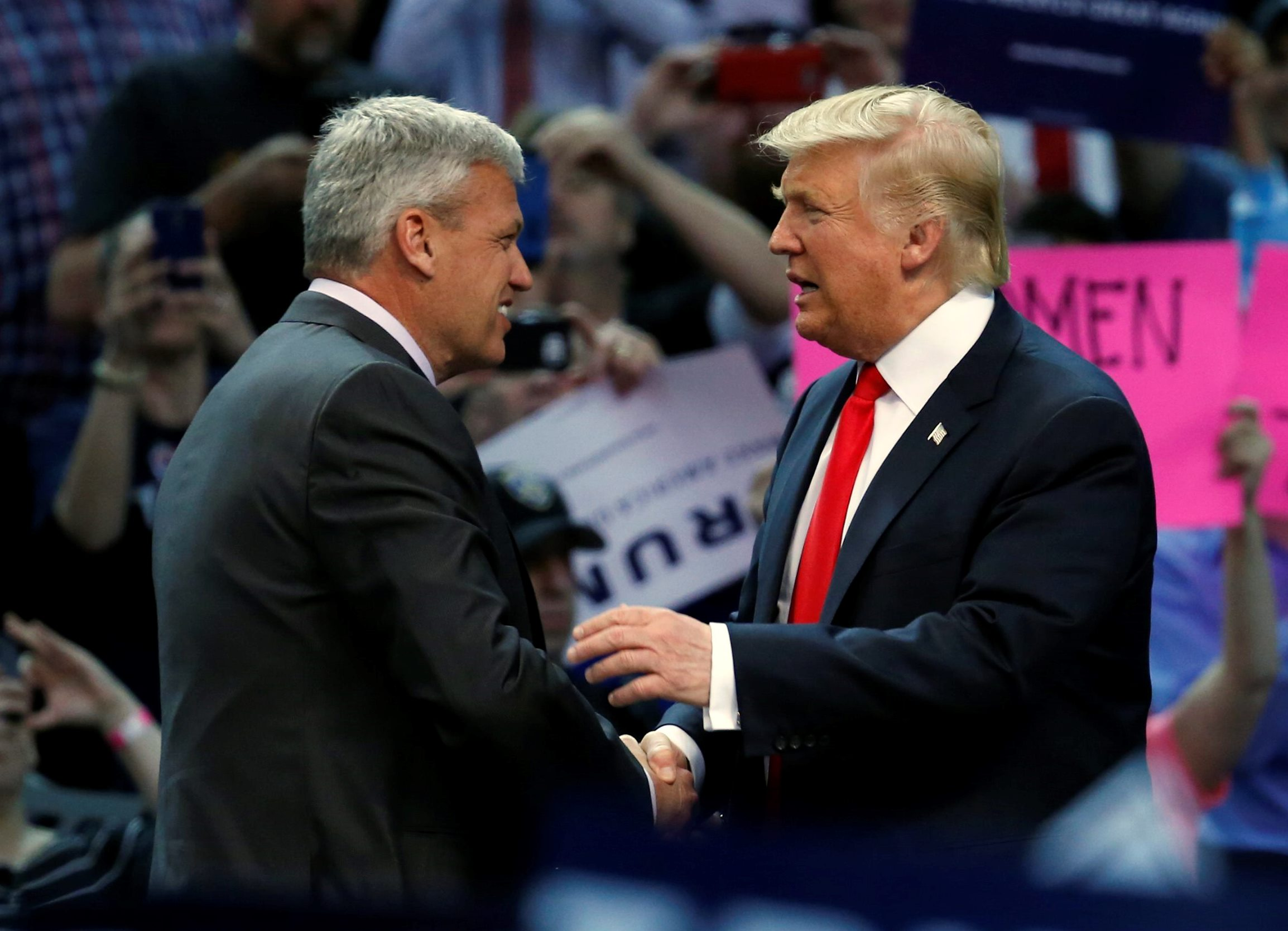 Buffalo Bills coach Rex Ryan shakes hands with Donald Trump after introducing him at a campaign rally in KeyBank Center last April. Would Ryan be the Bills' coach now if Trump had purchased the team in 2014? (Harry Scull Jr./Buffalo News)