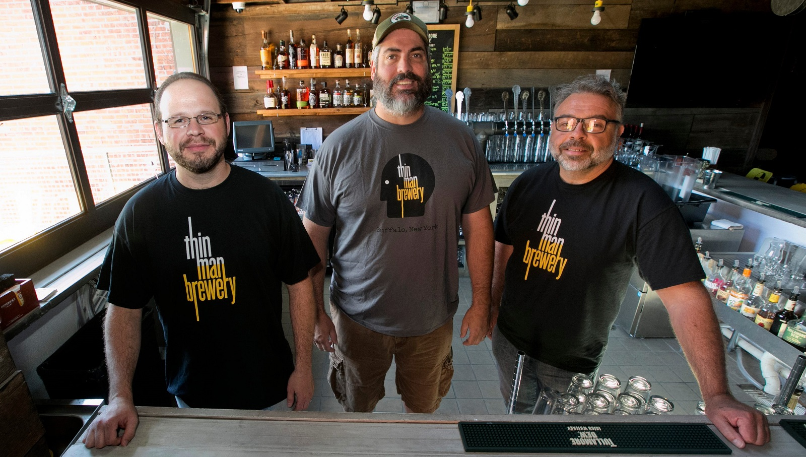 Thin Man Brewing's Rudy Watkins, left, pictured with owner Mike Shatzel and GM Mike Piganowski, will continue a focus on hoppy beers. (John Hickey/Buffalo News file photo)