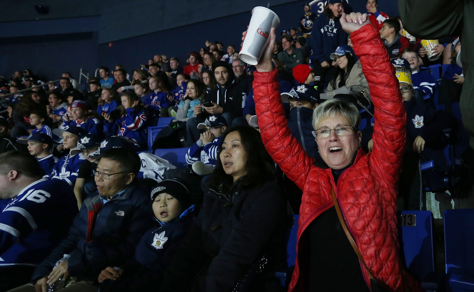 Michelle Krzemien of Darien is one of the few to celebrate the Sabres lone goal in a section that is mostly filled with Leafs fans. (Sharon Cantillon/Buffalo News)