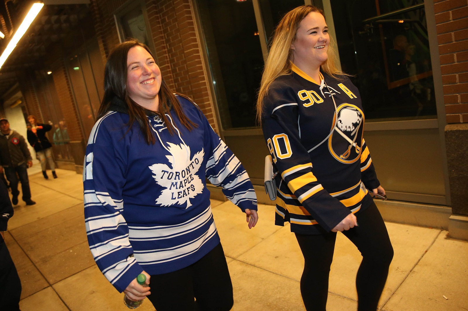 Lynsey Bedrosian, left, of Toronto, brought her friend Laura Gaca, of Toronto, for her birthday, but they rooted for different teams. (Sharon Cantillon/Buffalo News)