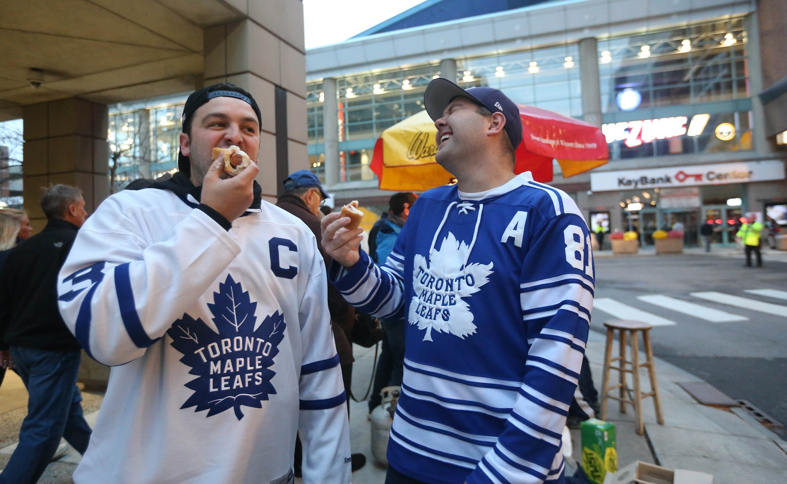 Leafs fans Matthew Salewski, left, and Shawn Wilson, of Niagara Falls, Ontario, have some hotdogs before going into the game. They prefer to attend Leafs games in Buffalo at a fraction of the cost to ones in Toronto. (Sharon Cantillon/Buffalo News)