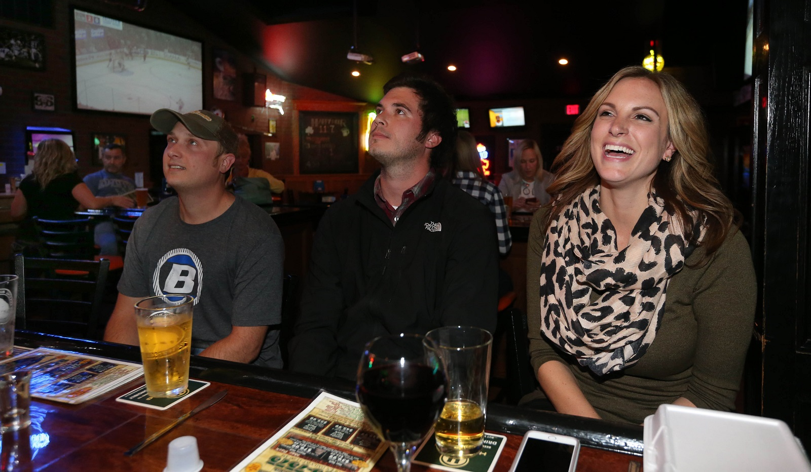 Watching the Sabres game in Mooney's, from left, are Jon Karcher of Depew, Kyle Krawczyk of West Seneca and Amanda Edel of West Seneca. (Sharon Cantillon/Buffalo News)