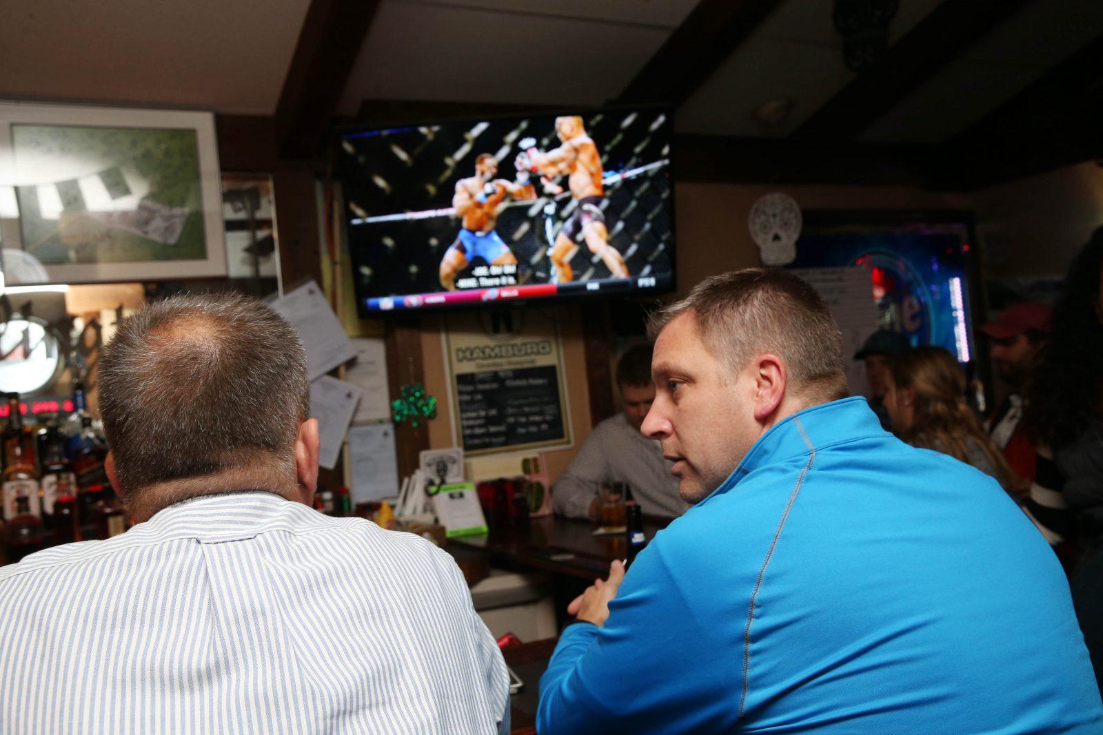 Karl Kozlowski, left, of Buffalo, and Andrew Ray, catch a boxing match on TV at the Wellington Pub.    (Sharon Cantillon/Buffalo News)