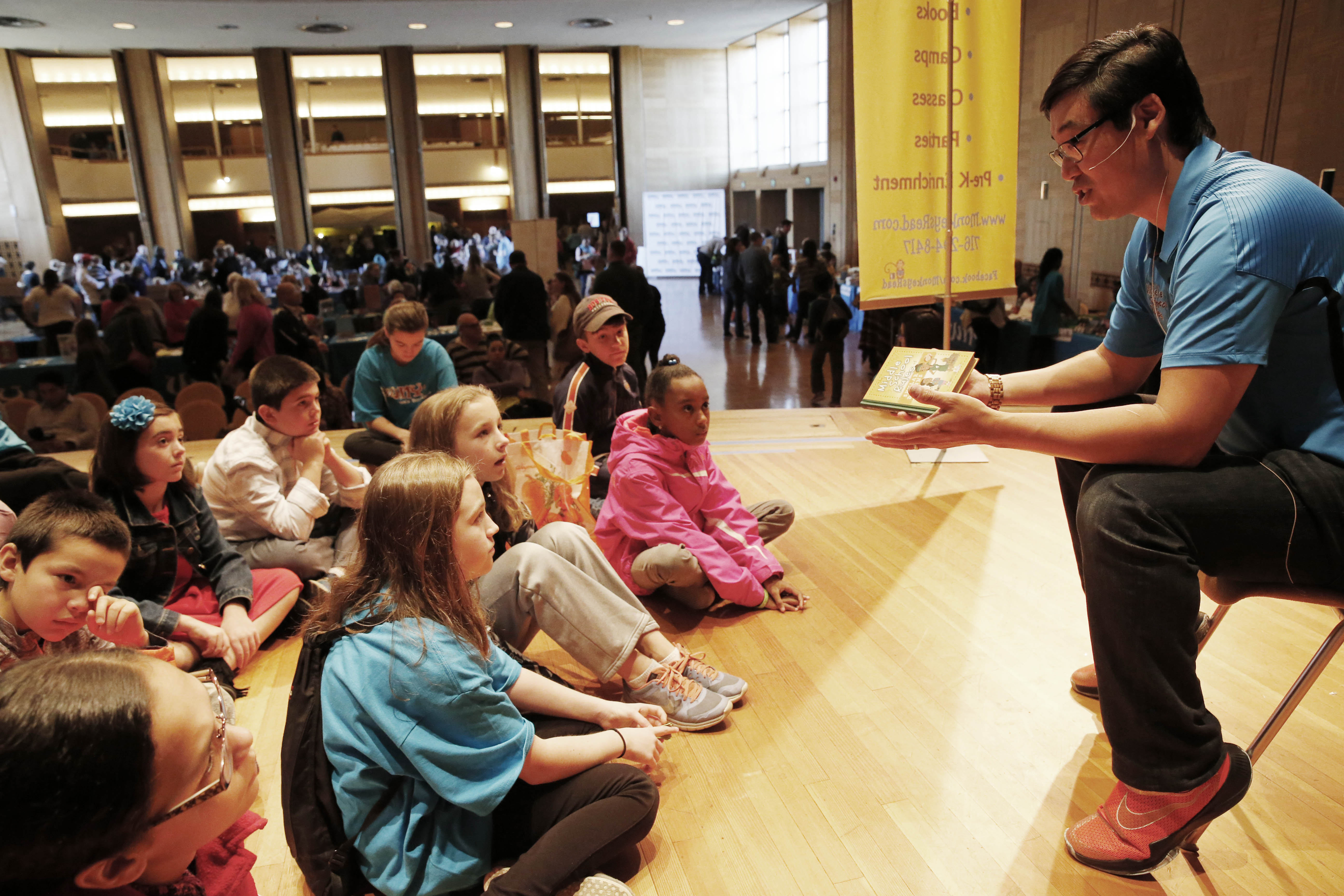 Author Sean Jensen takes questions from kids after reading from his book, 'The Middle School Rules of Skylar Diggins,' at the WNY Children's Book Expo  on Sunday.  (Derek Gee/Buffalo News)