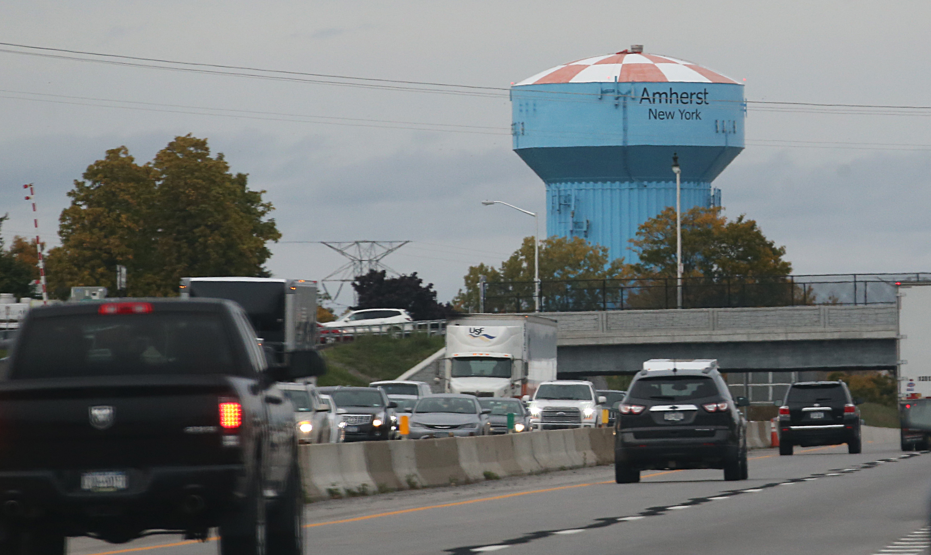 The Town of Amherst blue water tower is ever visible during rush hour traffic. The ECWA is increasing fees on commercial users for treatment plant and water tower construction projects.  (Sharon Cantillon/Buffalo News)