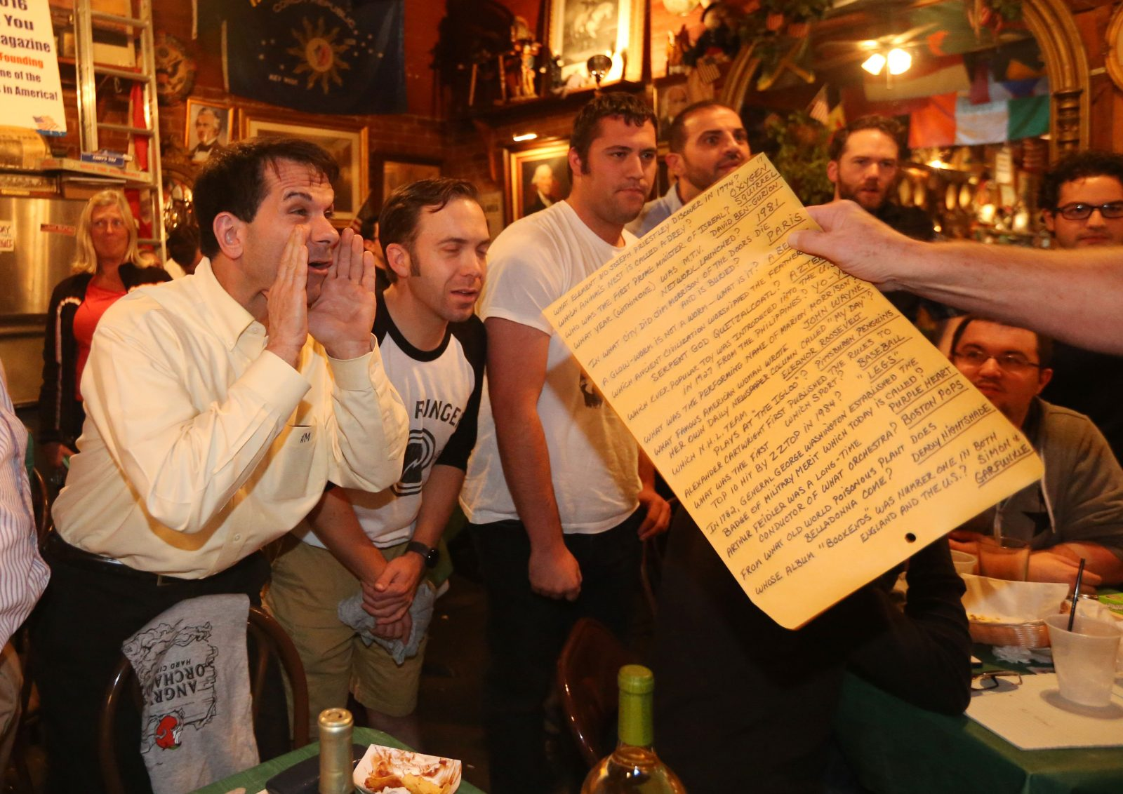 Joseph Montante, left, shouts out the correct answer during the popular First Tuesday Trivia Night at Founding Father's Pub.  (Sharon Cantillon/Buffalo News)