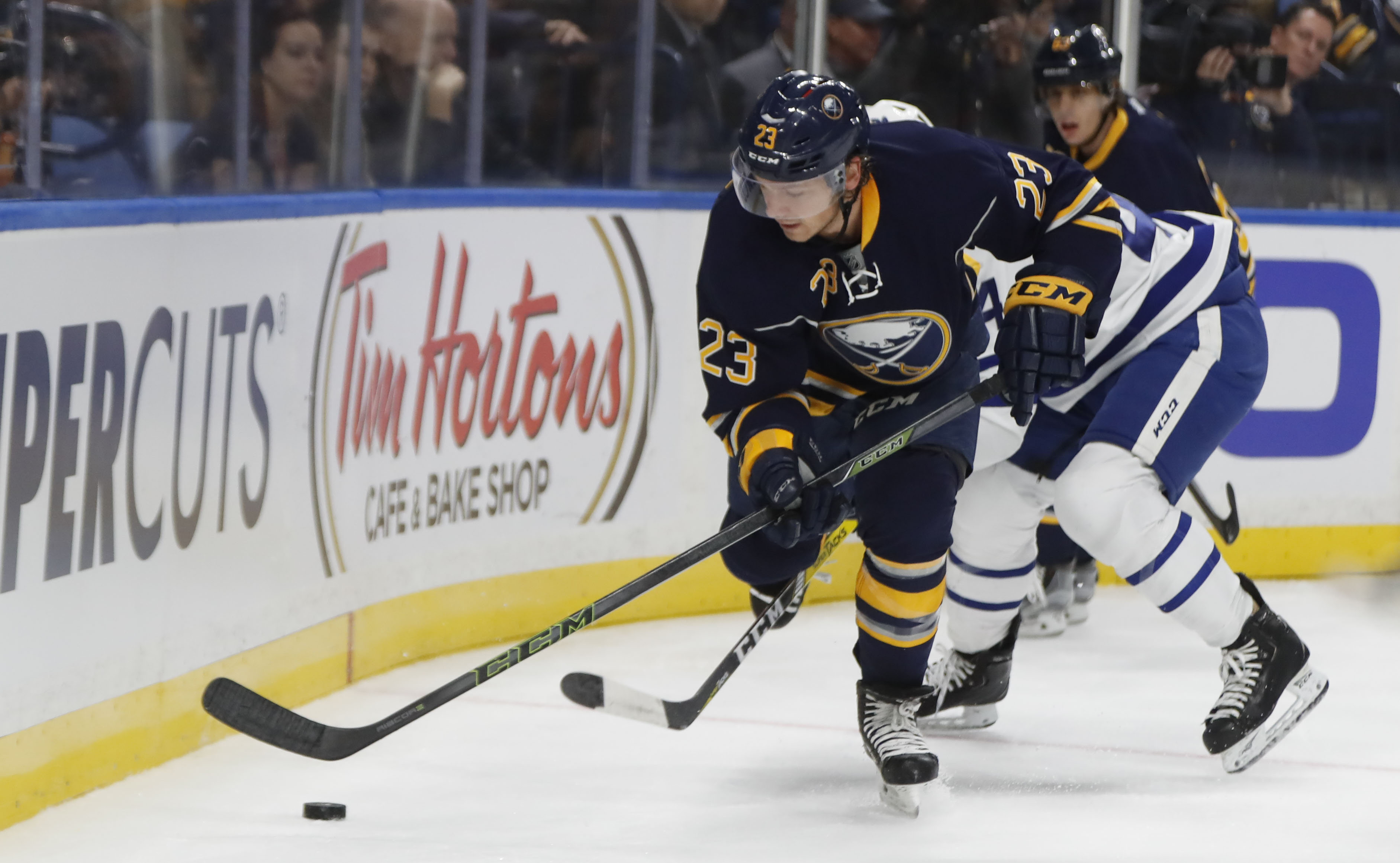 Sam Reinhart works down low against the Toronto Maple Leafs during first period action Thursday (Harry Scull Jr./Buffalo News)
