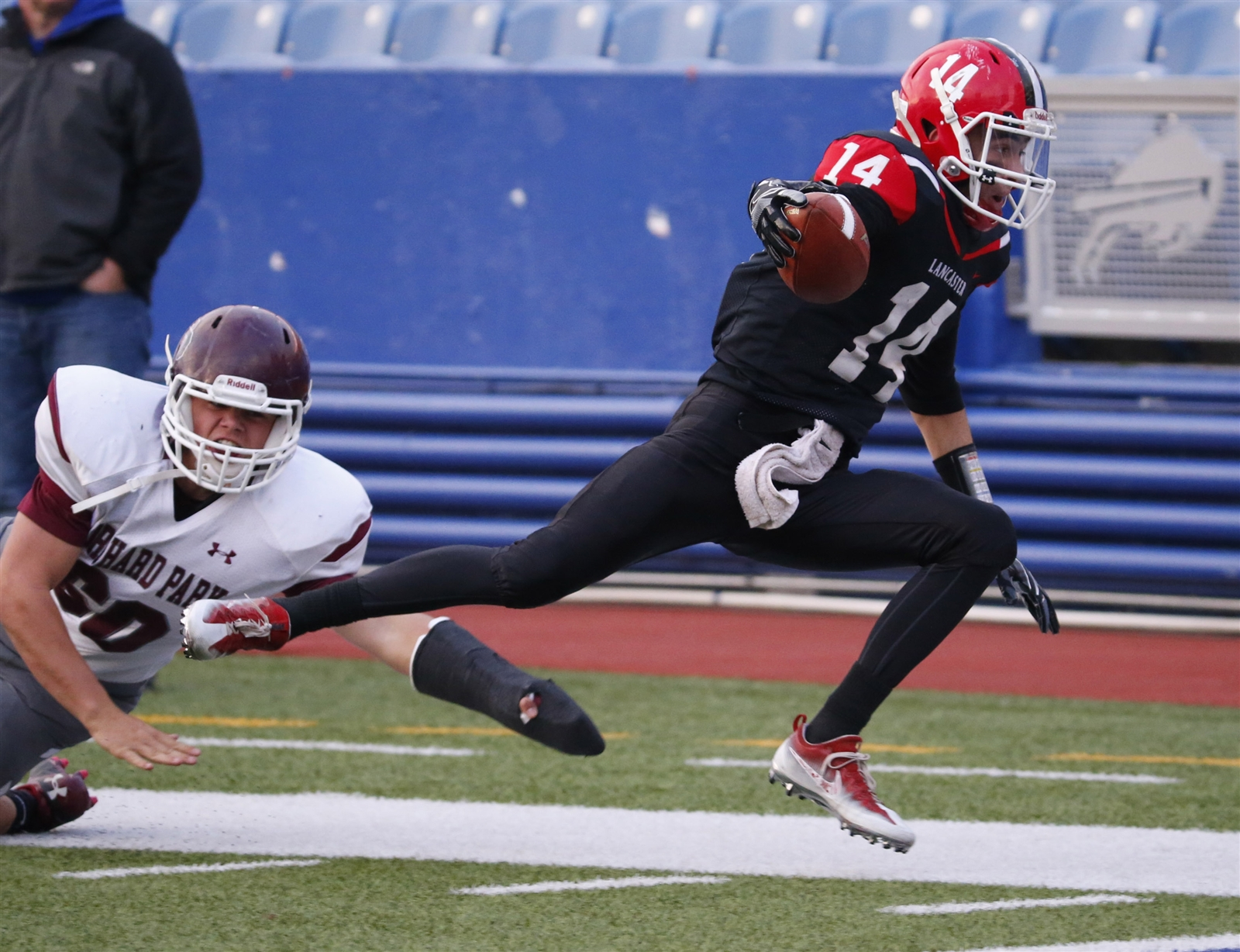 Max Giordano returns one of his three interceptions for Lancaster during last week's Section VI final triumph over Orchard Park. (Harry Scull Jr./Buffalo News)