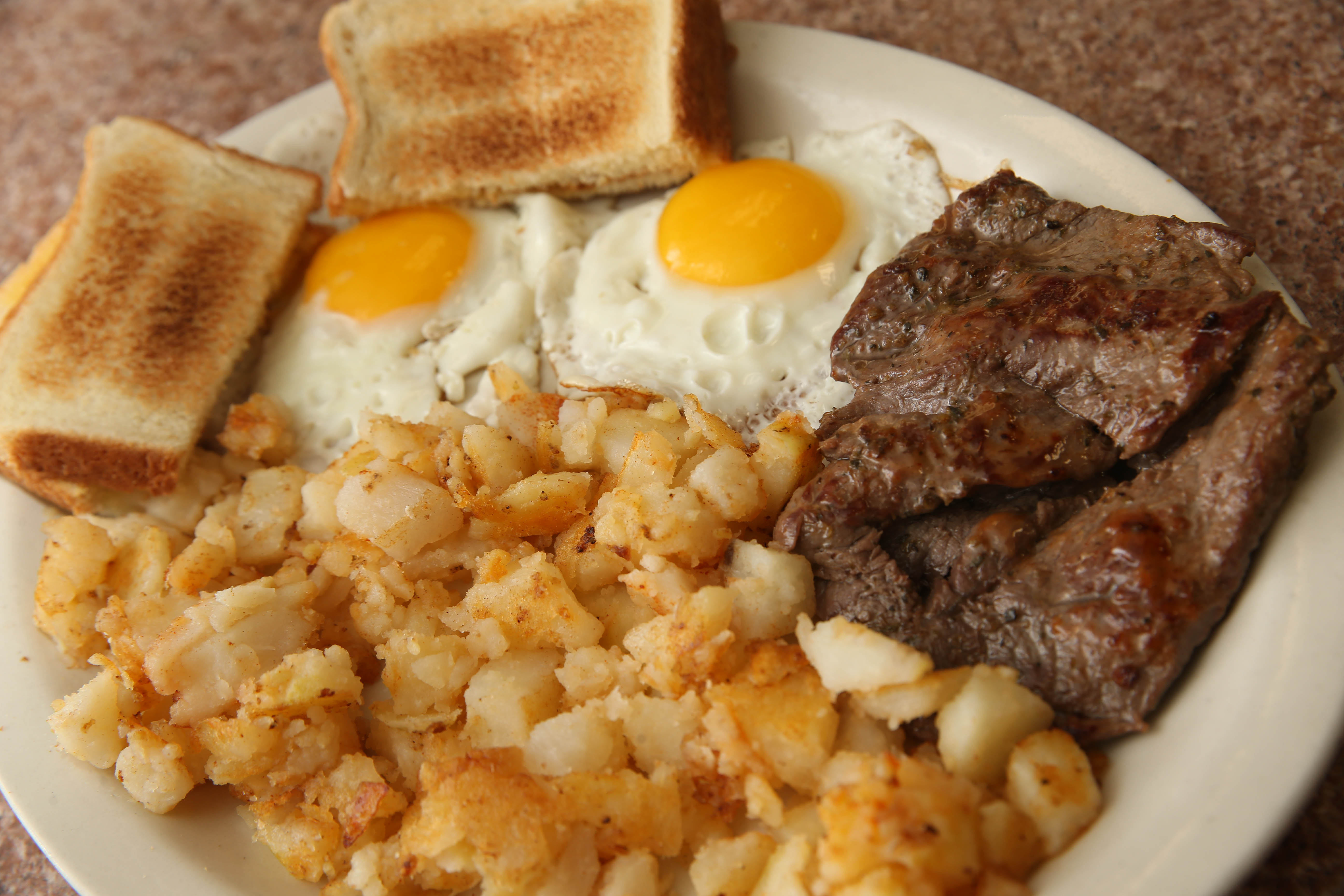 Steak and eggs with homefries and toast is ono of the popular dishes at Lucky's Texas Hots. (Sharon Cantillon/Buffalo News)