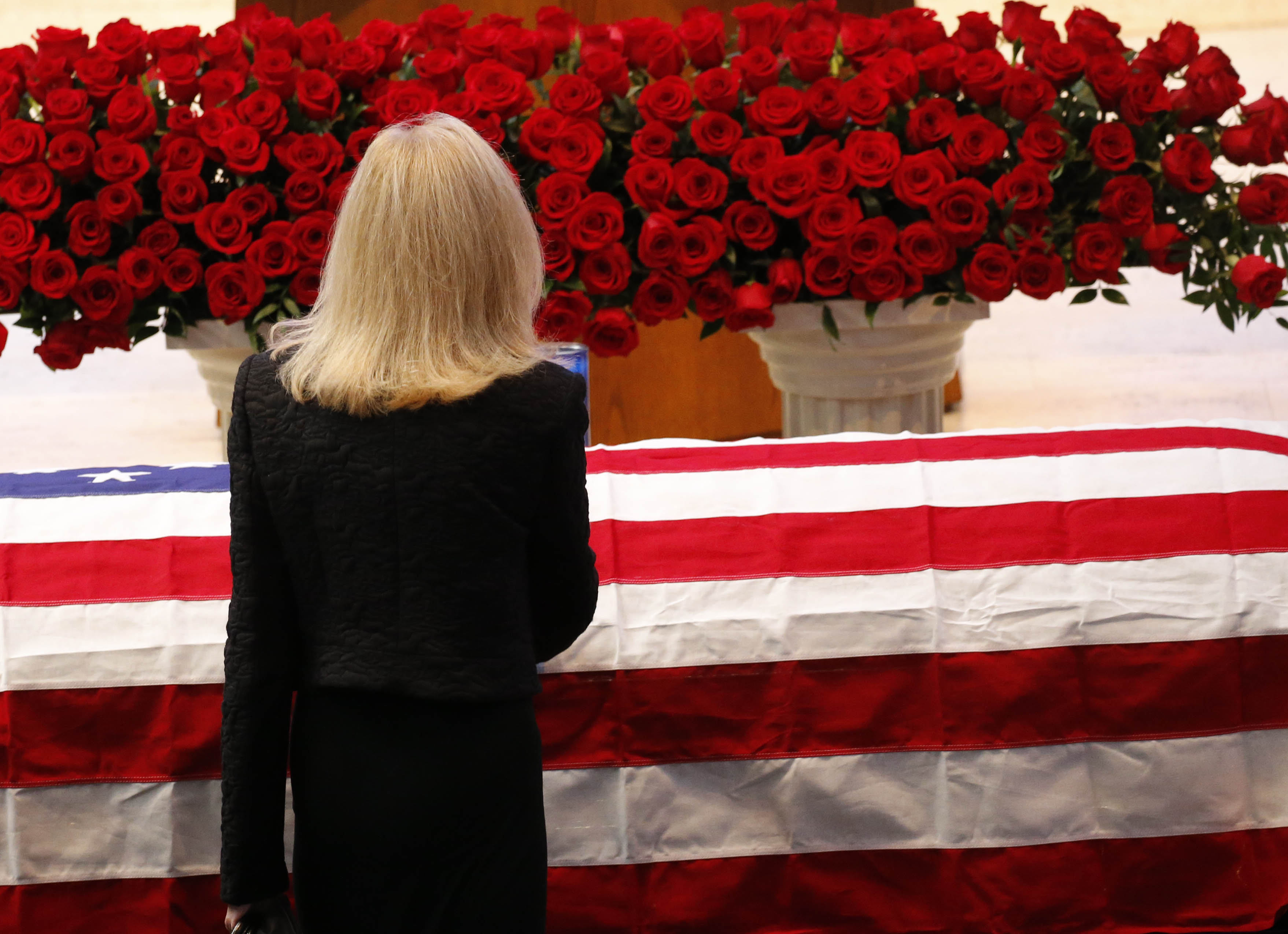 Judith Lipsey pauses at the casket of her husband, Stanford Lipsey, long-time publisher of The Buffalo News, at the start of his funeral service at Temple Beth Zion in Buffalo, Sunday, Nov. 6, 2016. (Derek Gee/Buffalo News)